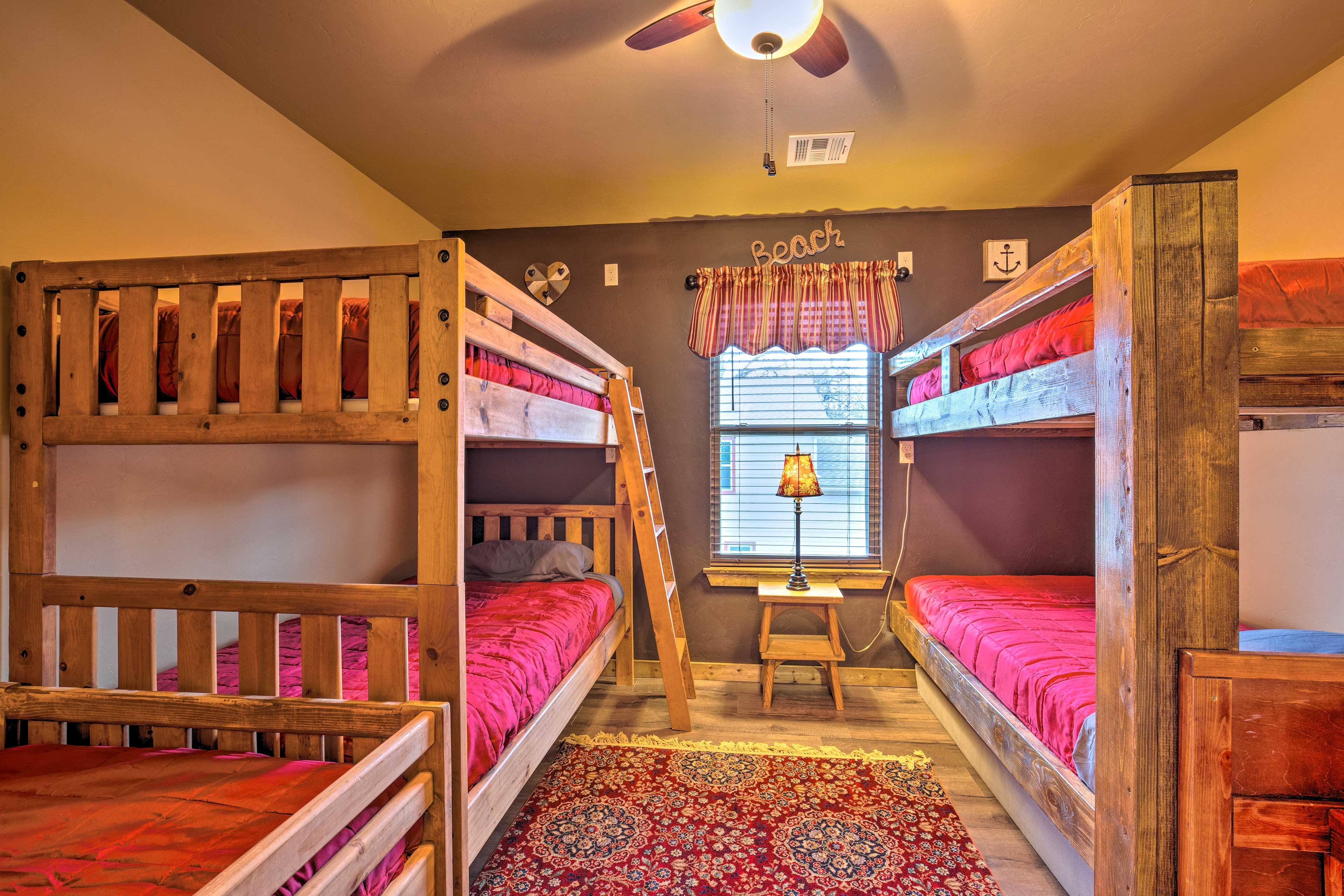 There are 7 twin bunk beds, total, in this room.