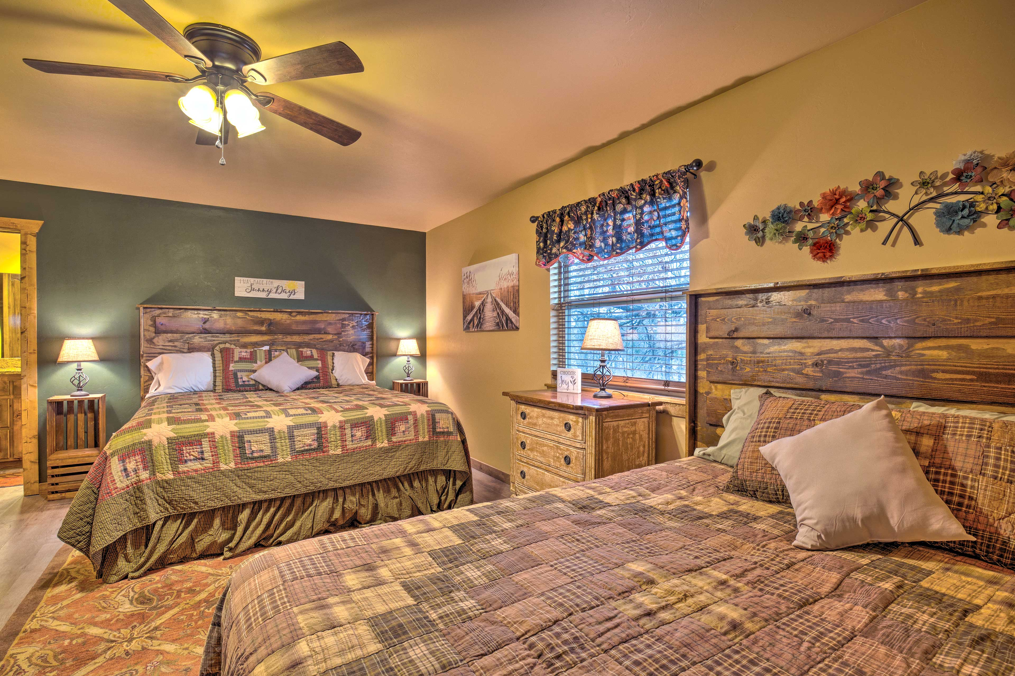 This room includes a king bed, queen bed, and twin bunk beds.