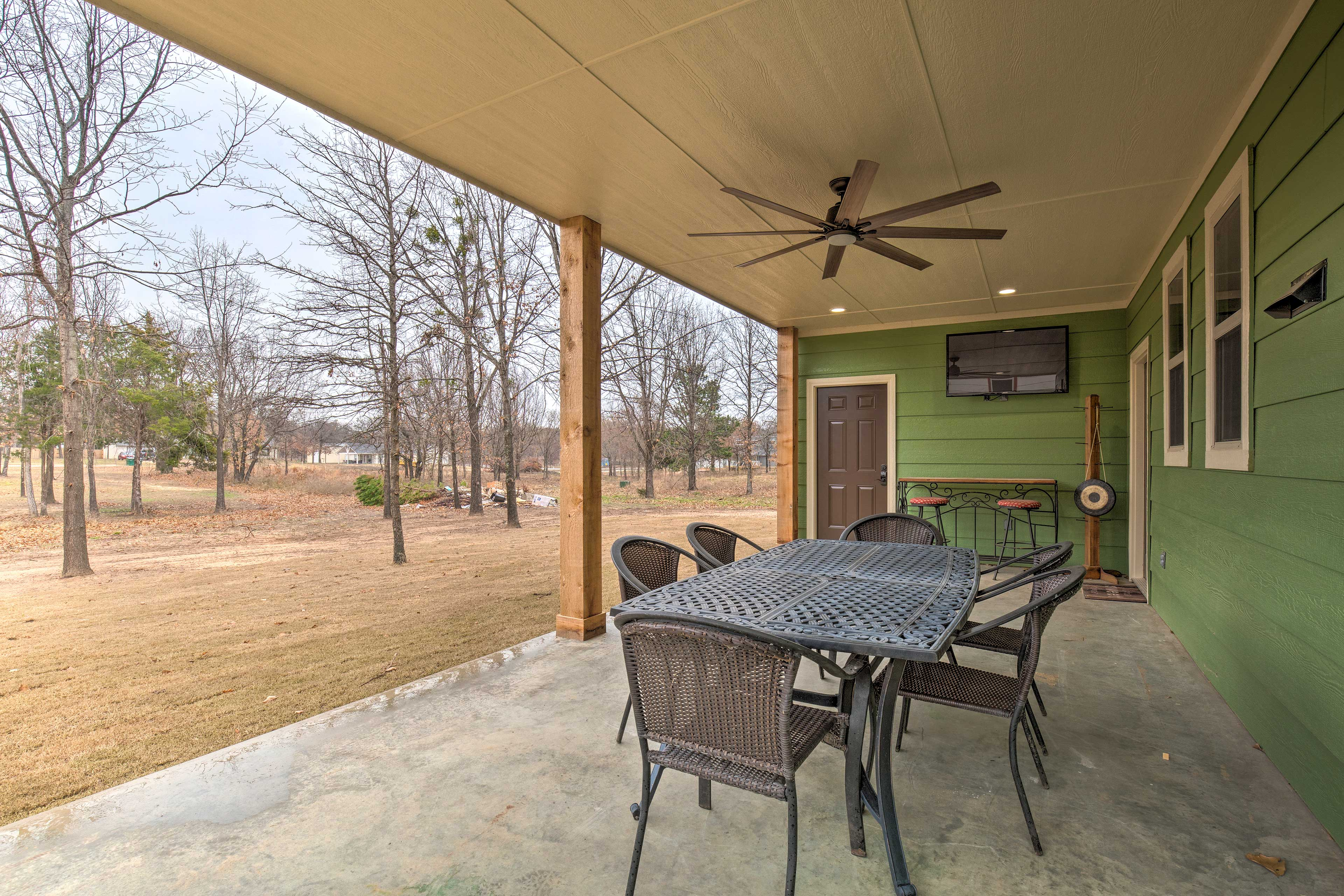 Relax, dine al fresco, and watch the big game on the covered patio.