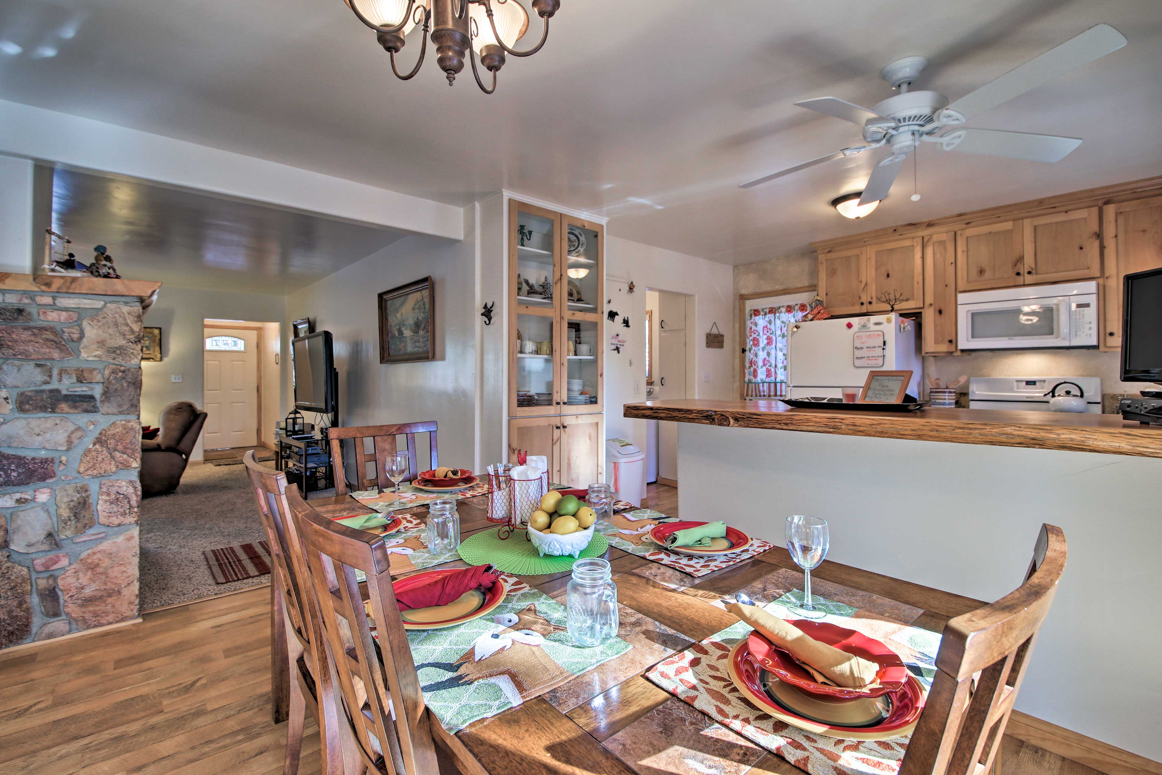 Through the open doorway, you'll find the dining area and kitchen.
