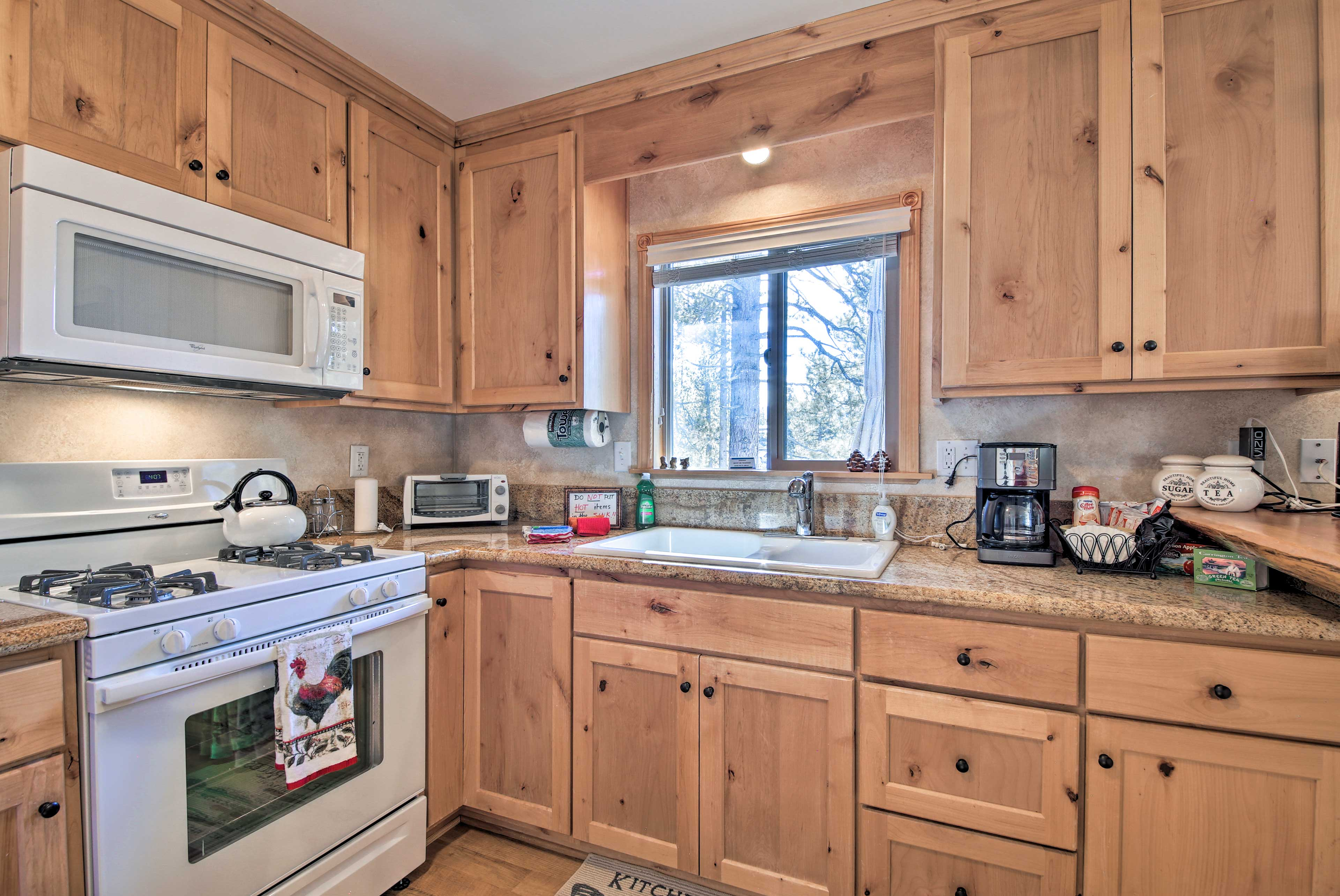 You'll find everything from a coffee maker & stove/oven to ample cookware here!