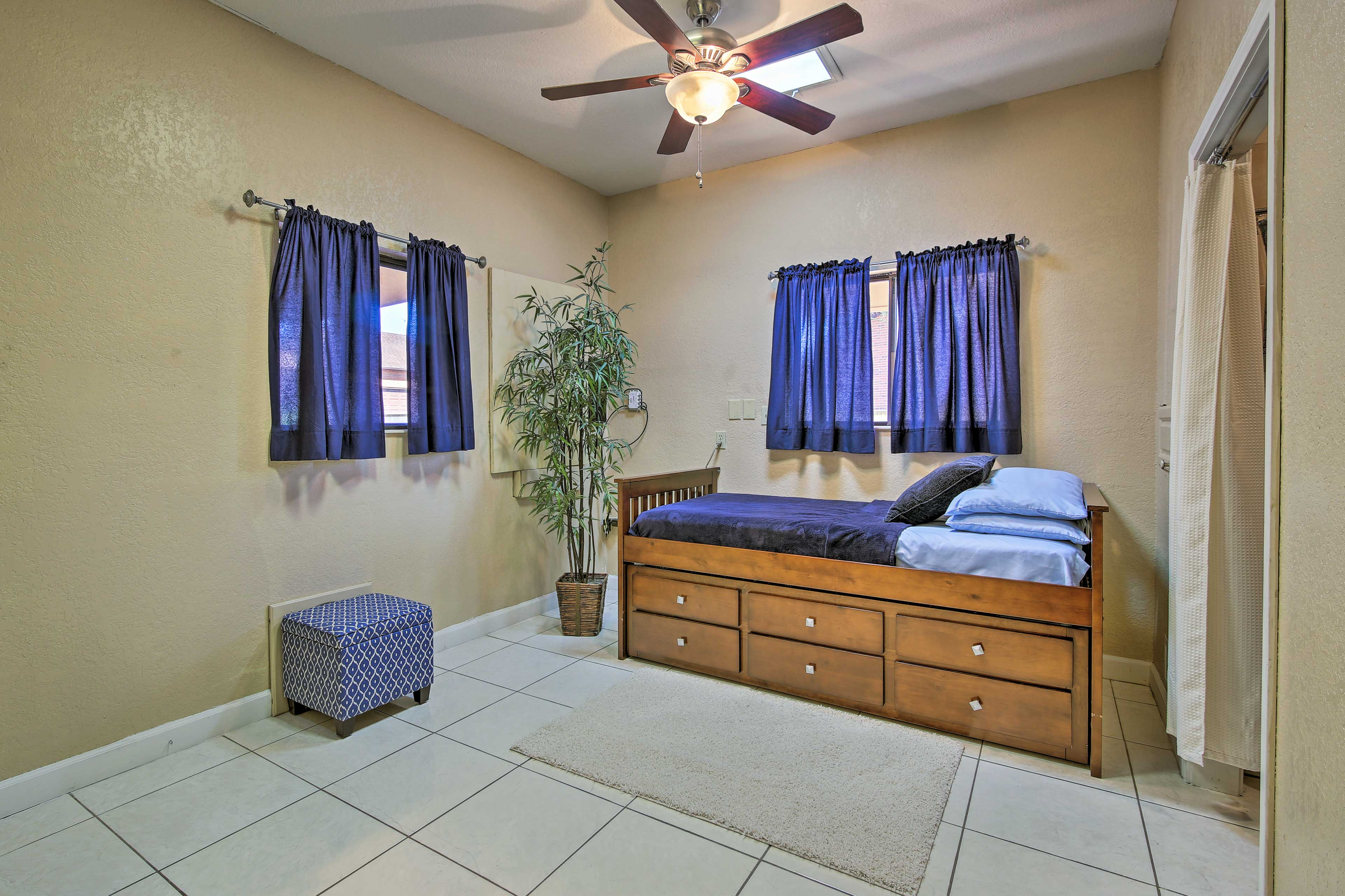 Additional sleeping awaits on this cozy twin bed.