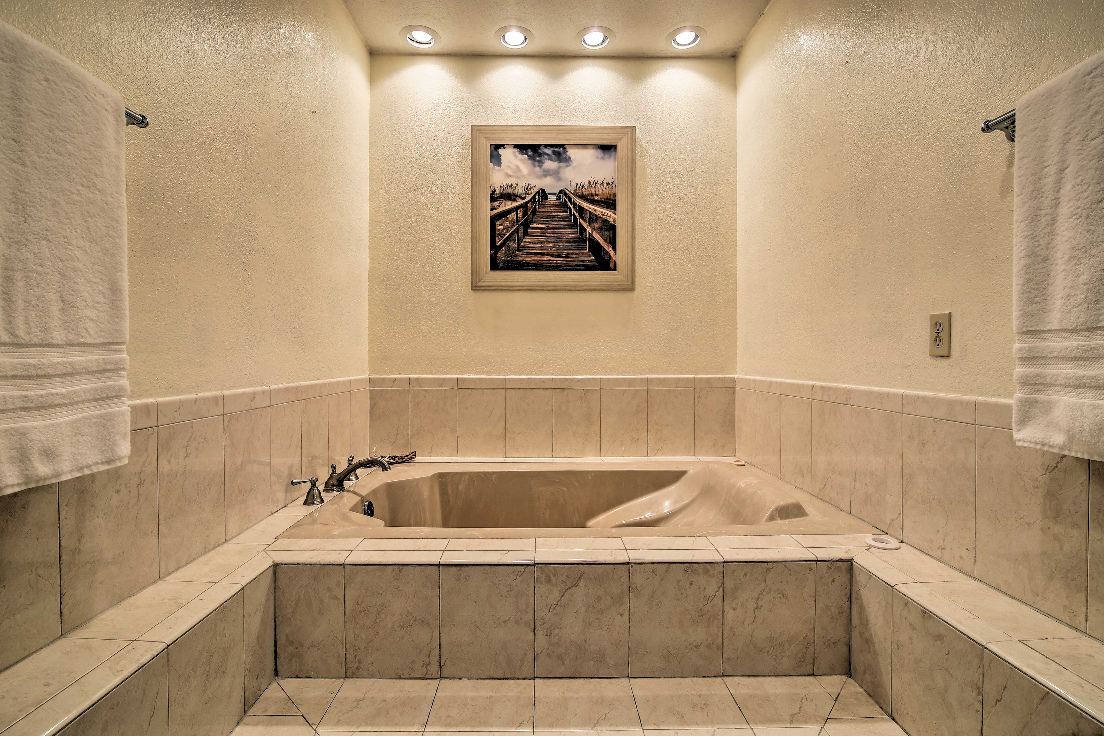 Soothing soaks await in this Jacuzzi tub.