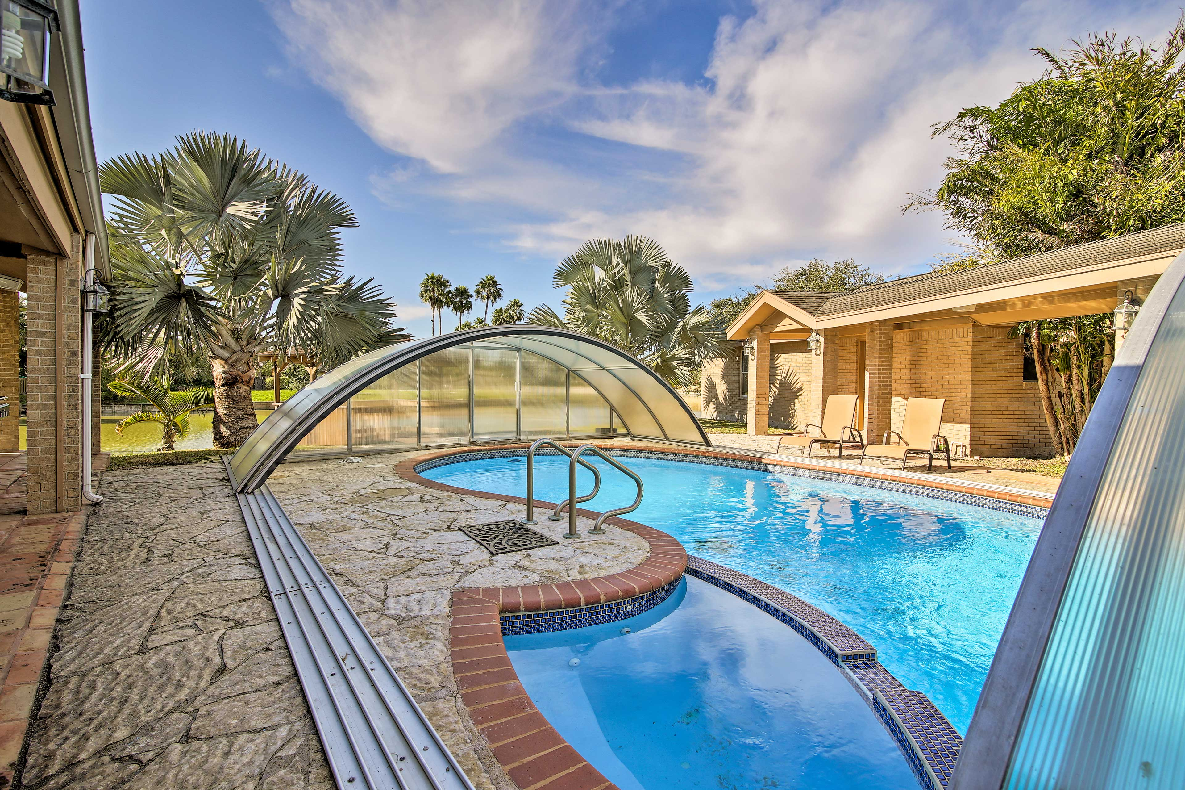 Capture the essence of Harlingen from this waterfront home with a pool and spa!