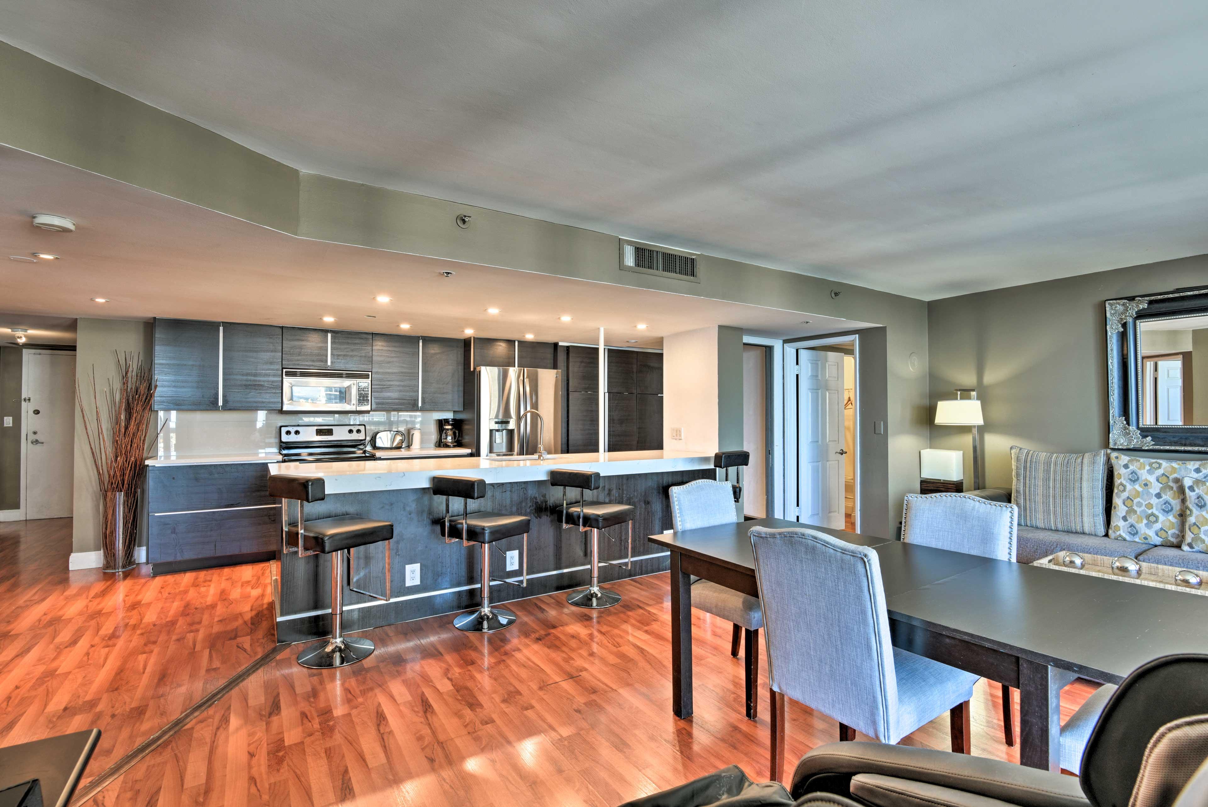 The penthouse boasts hardwood flooring and plenty of modern accents.