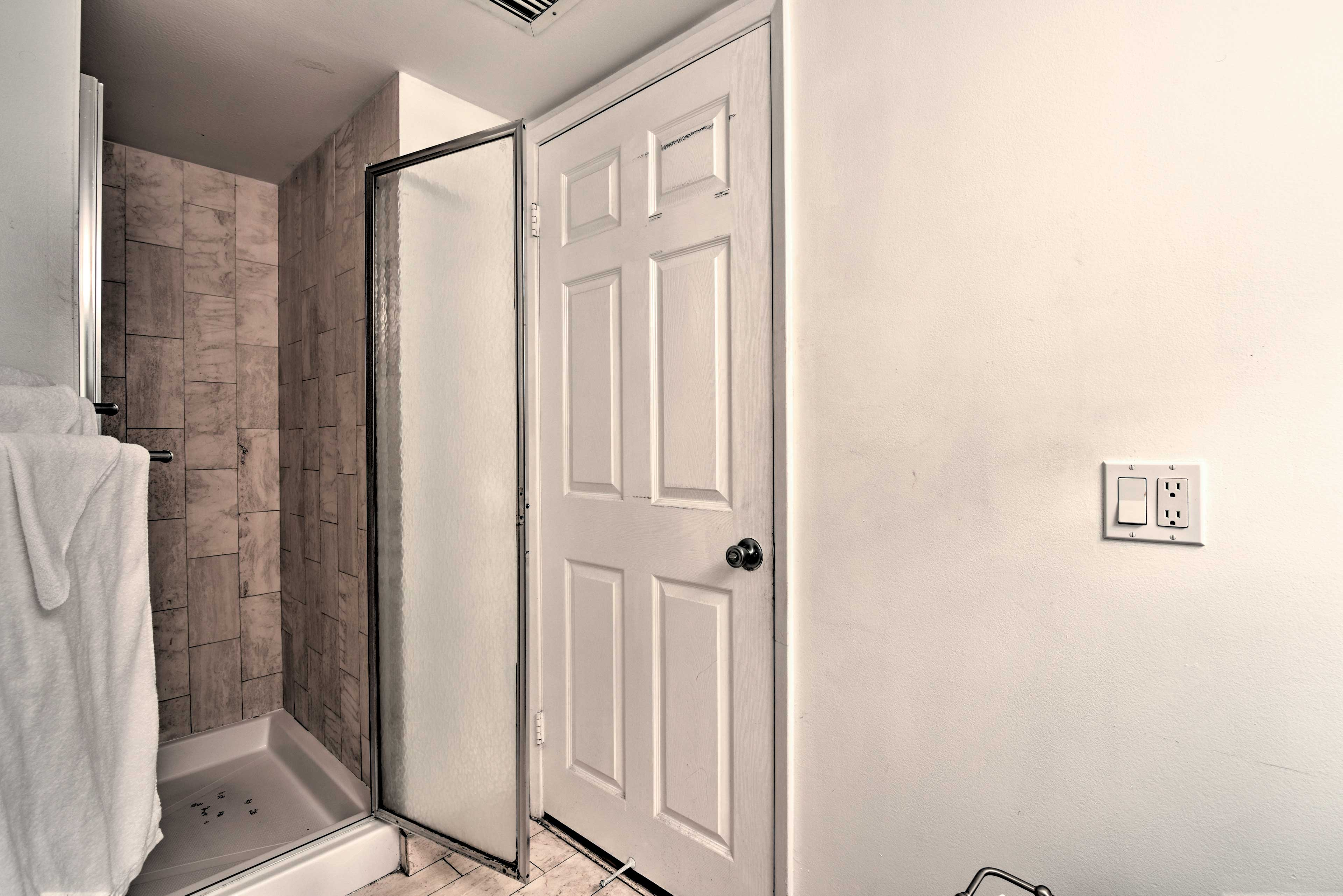 Rinse off the saltwater in the tile-lined stand-up shower.