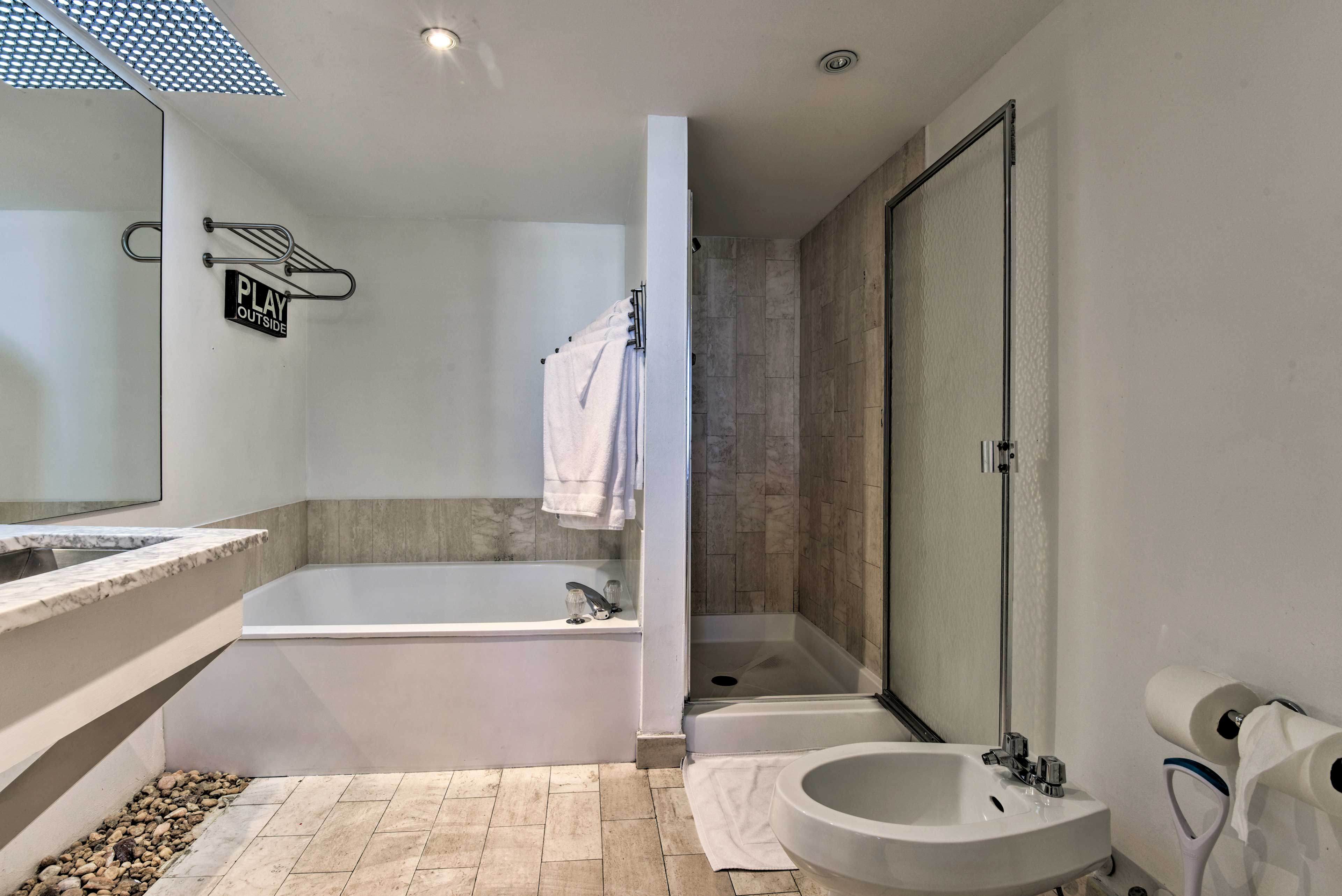 Rinse off in the large bathing tub or the stand-up shower.