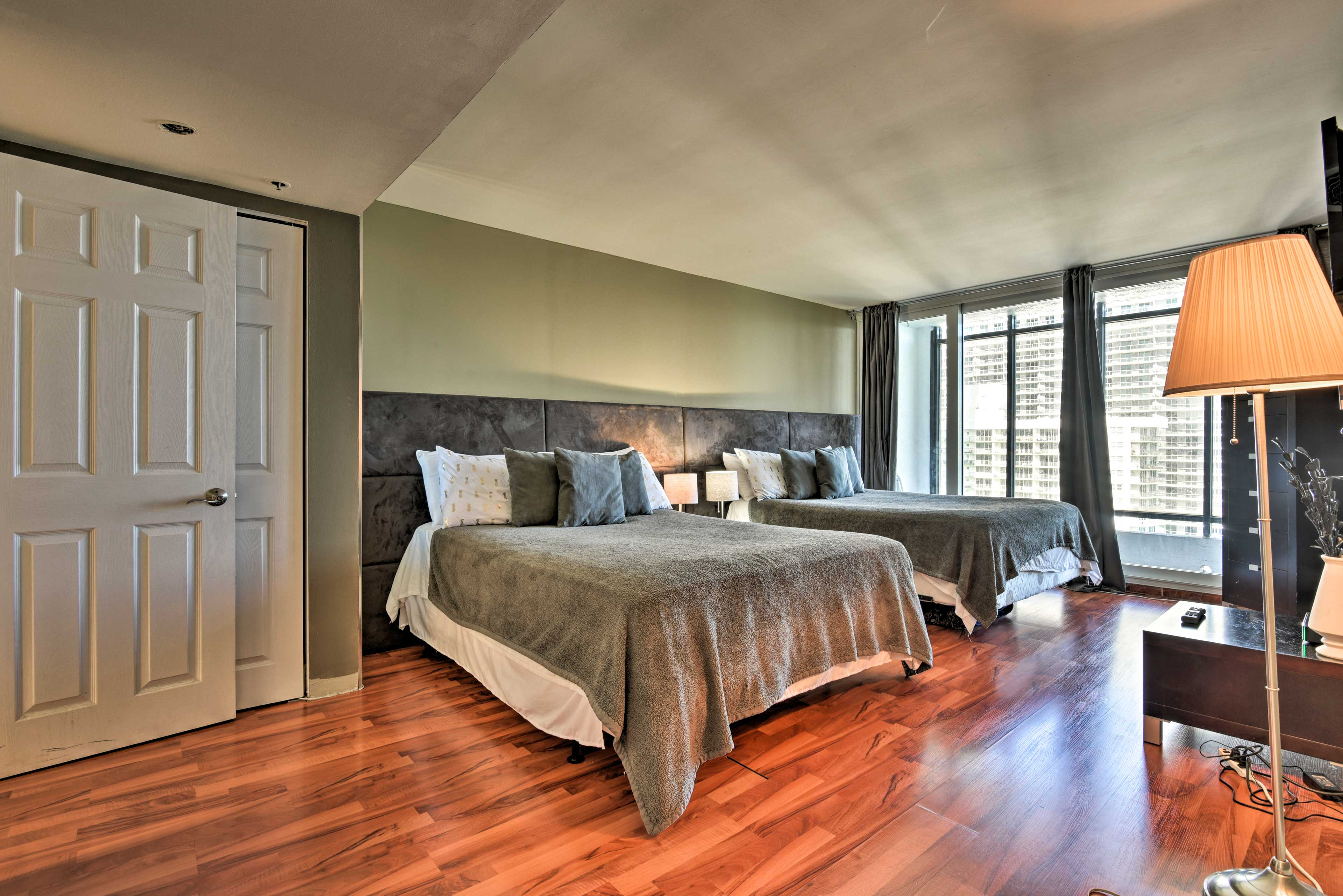 The first bedroom boasts 2 queen mattresses.
