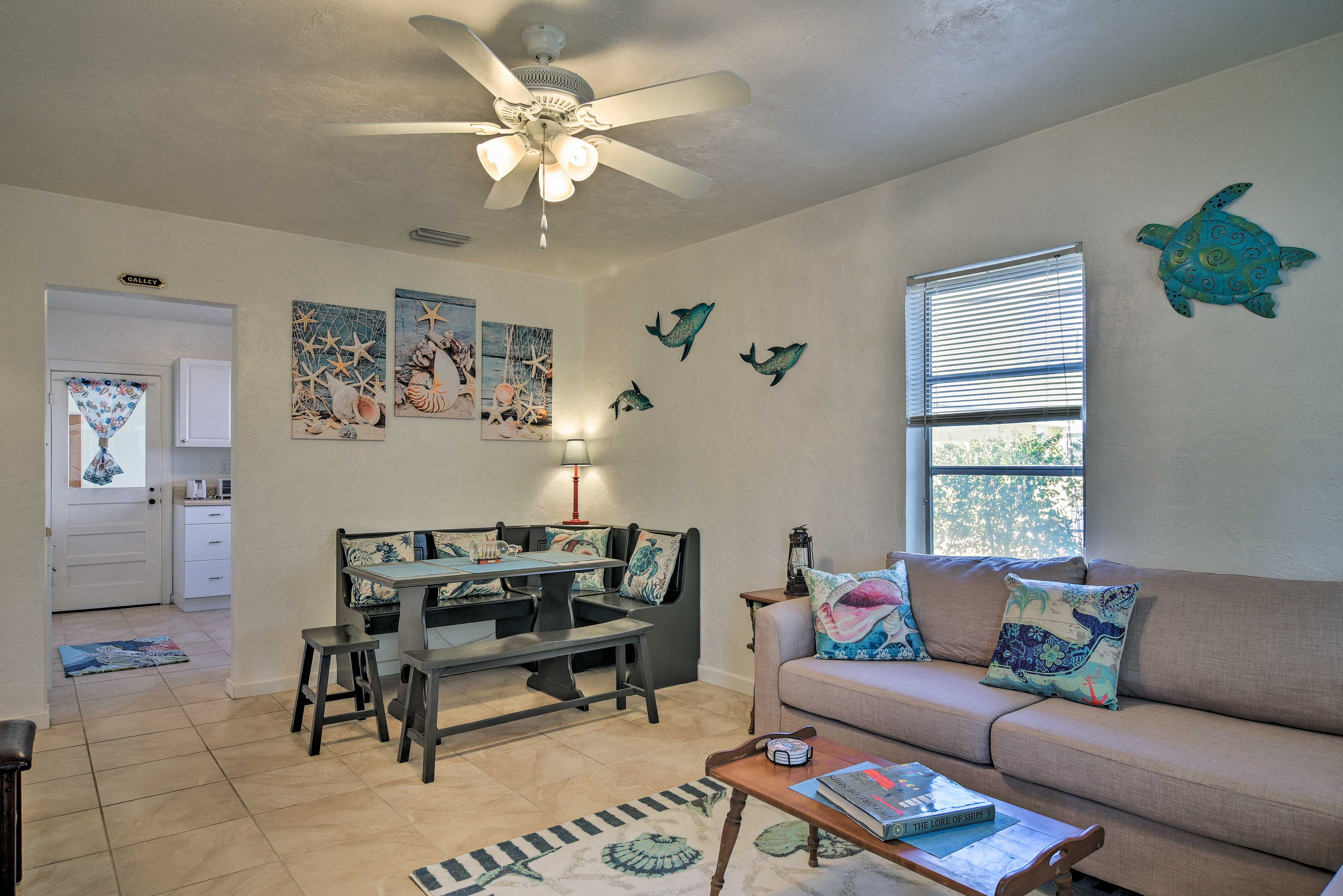The open living space carries a bright and breezy beach themed throughout!