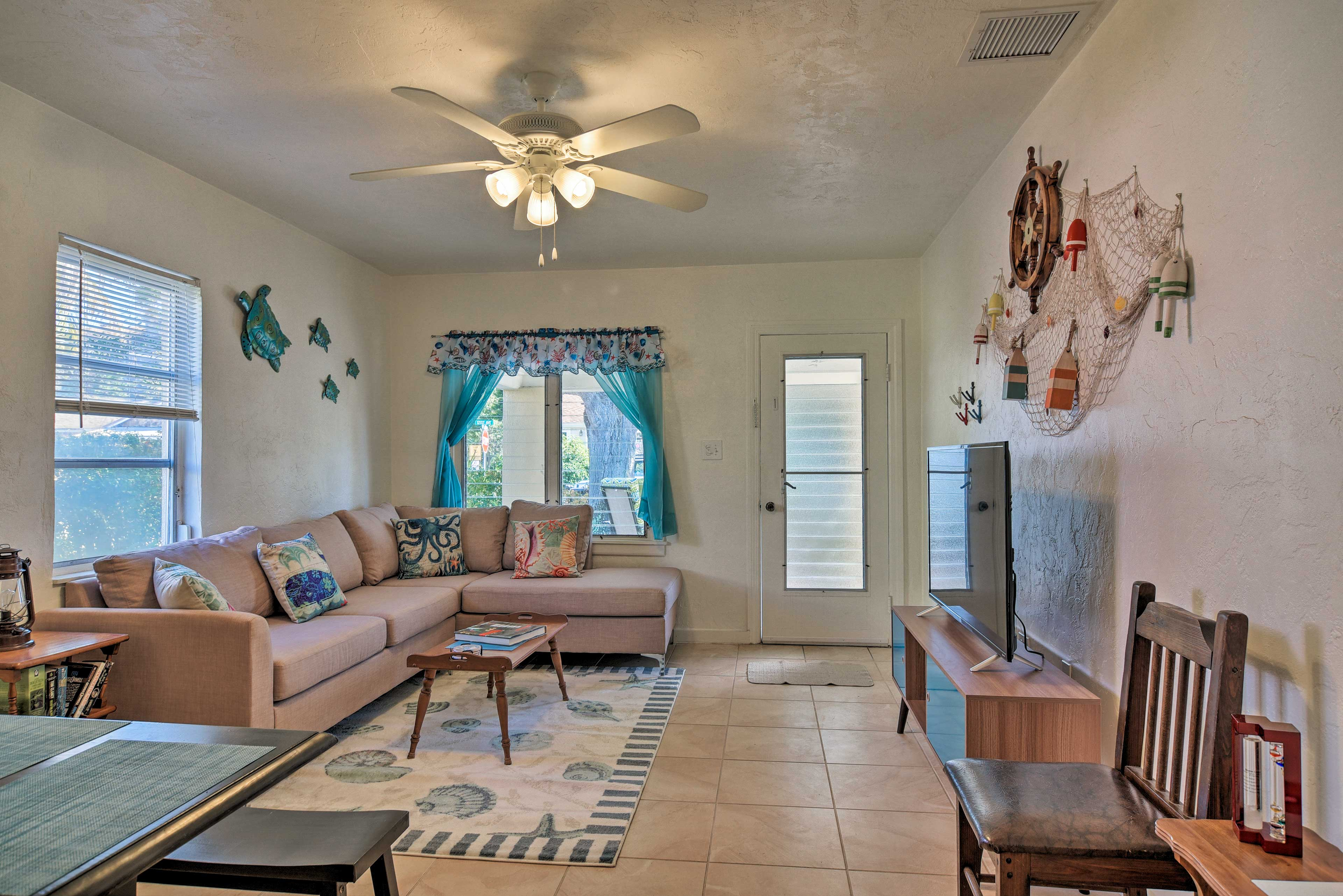 Home highlights include a cozy interior, full kitchen, garden patio, and more!