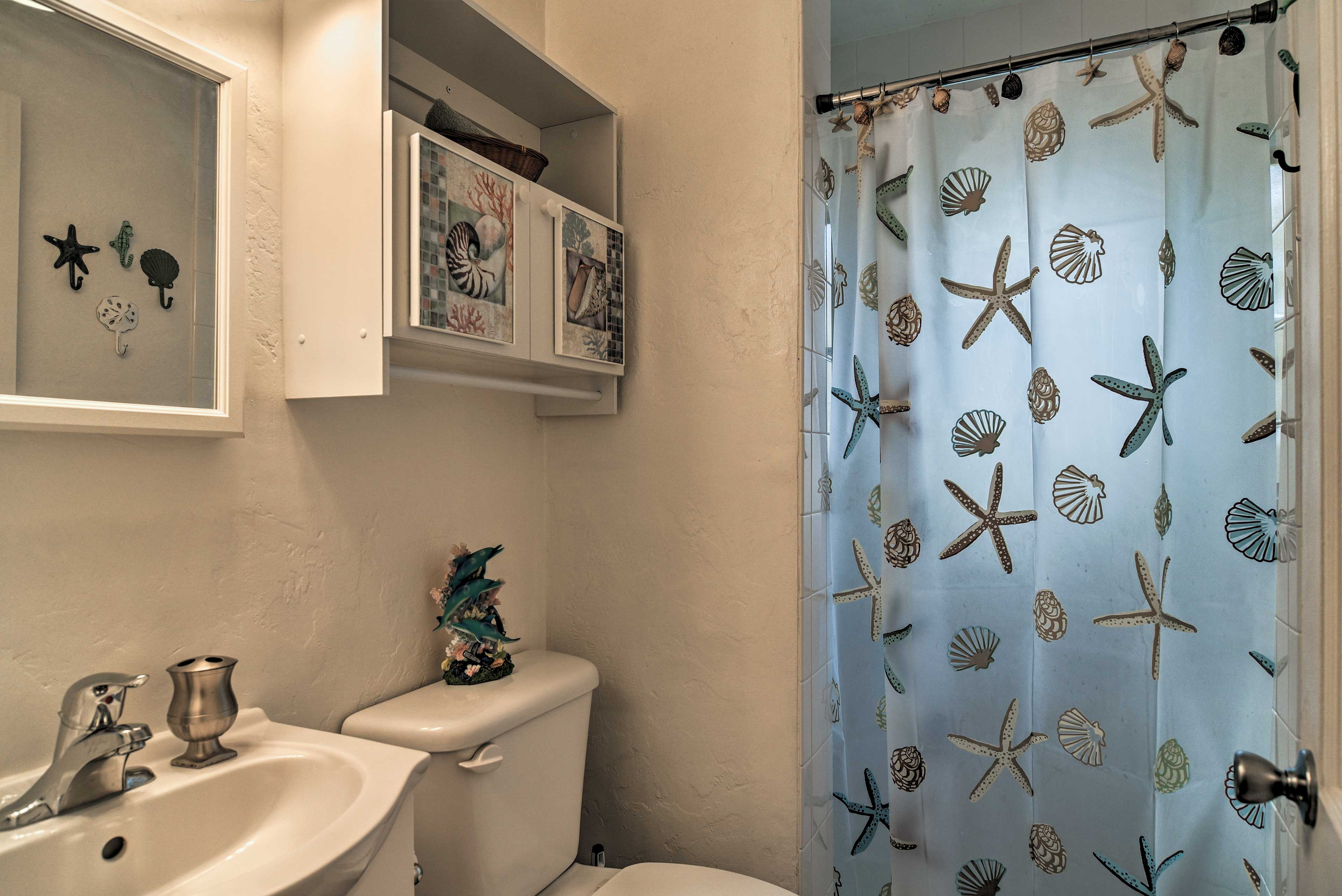 Wash away the sand from the day in the home's full bathroom.