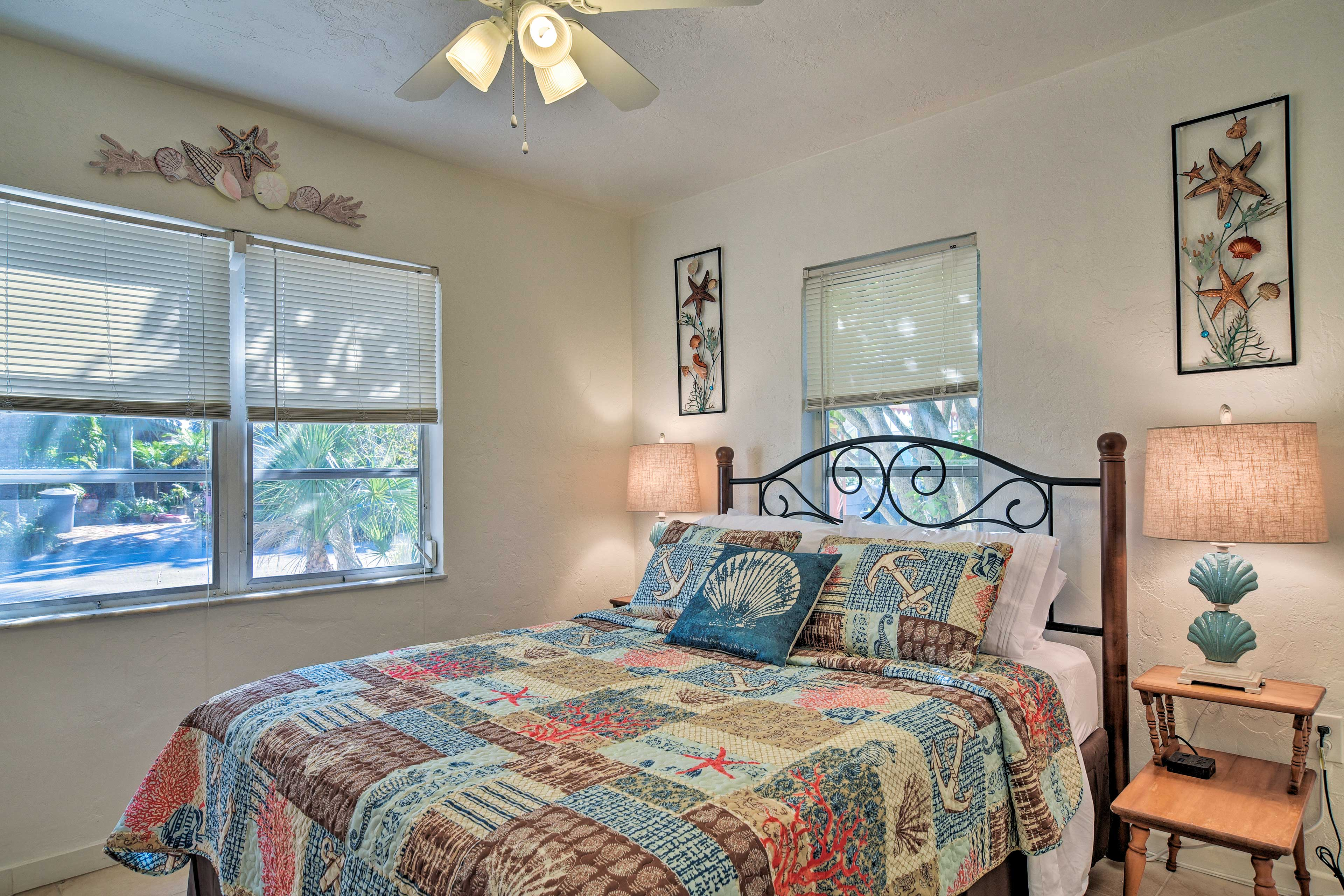The first bedroom features a plush queen-sized bed.
