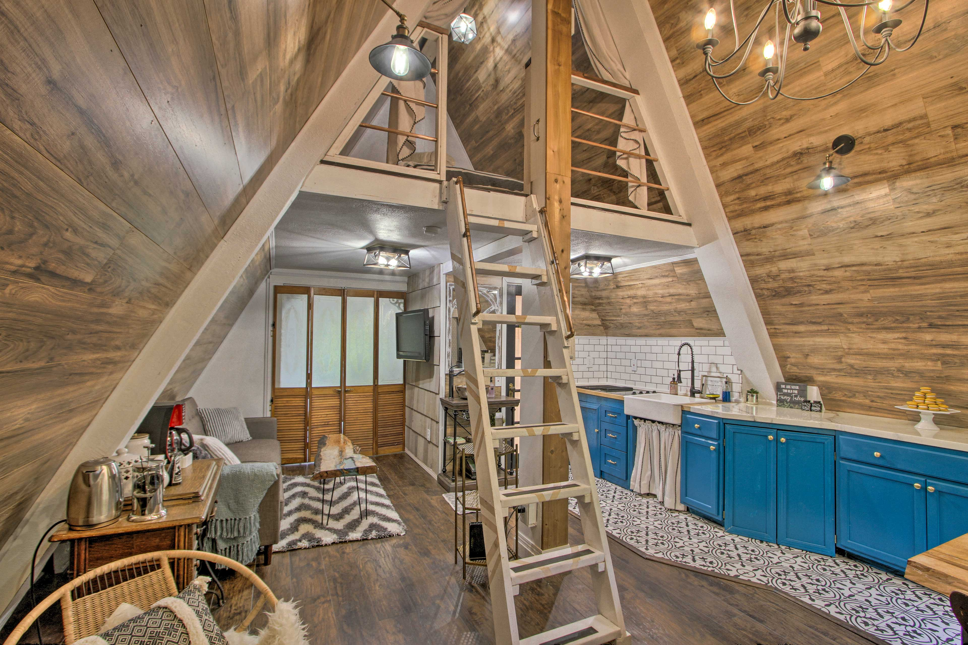The cottage includes 1 bedroom, 1 bathroom, & a loft!