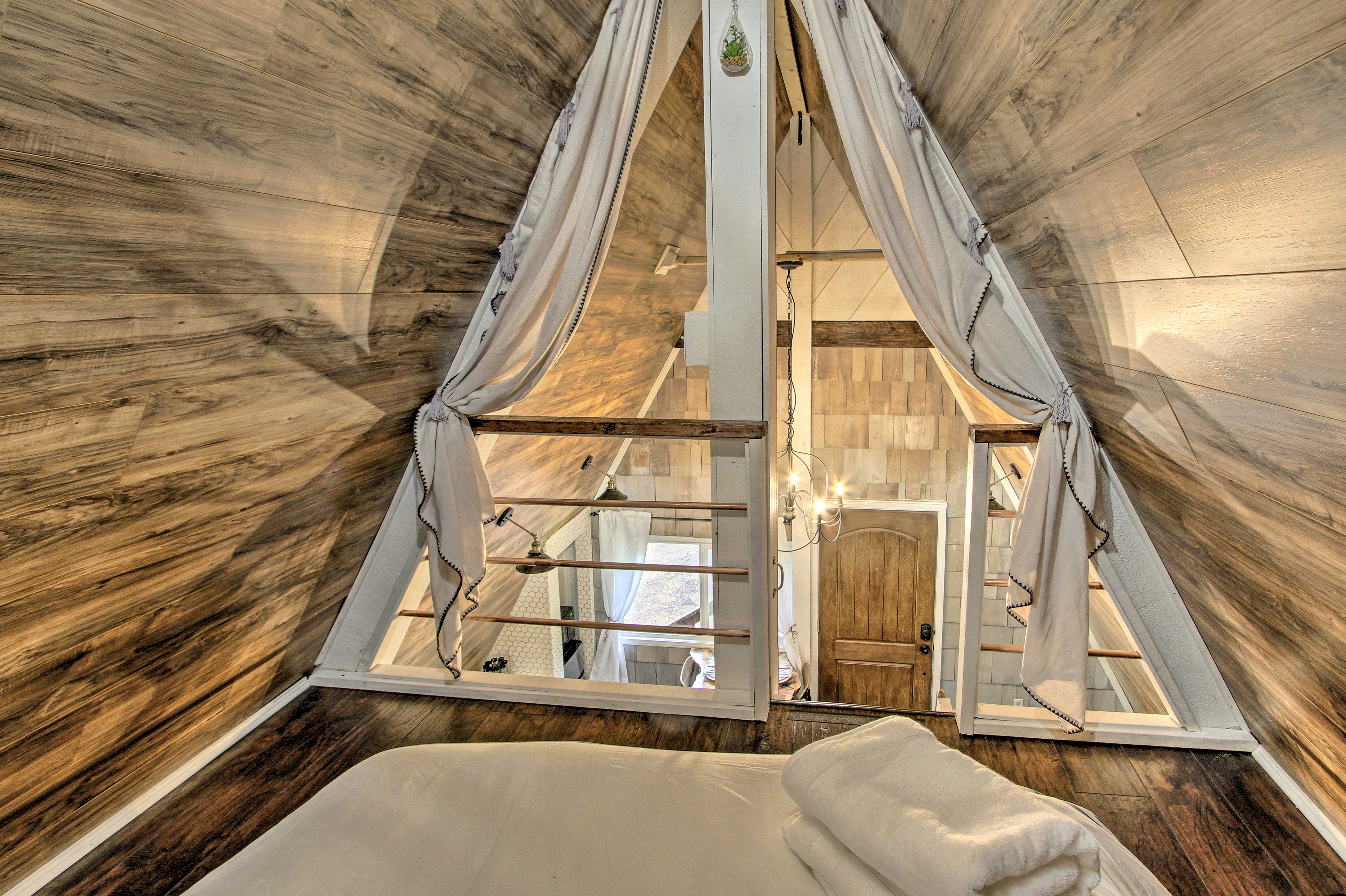 The loft houses a comfy full-sized bed.