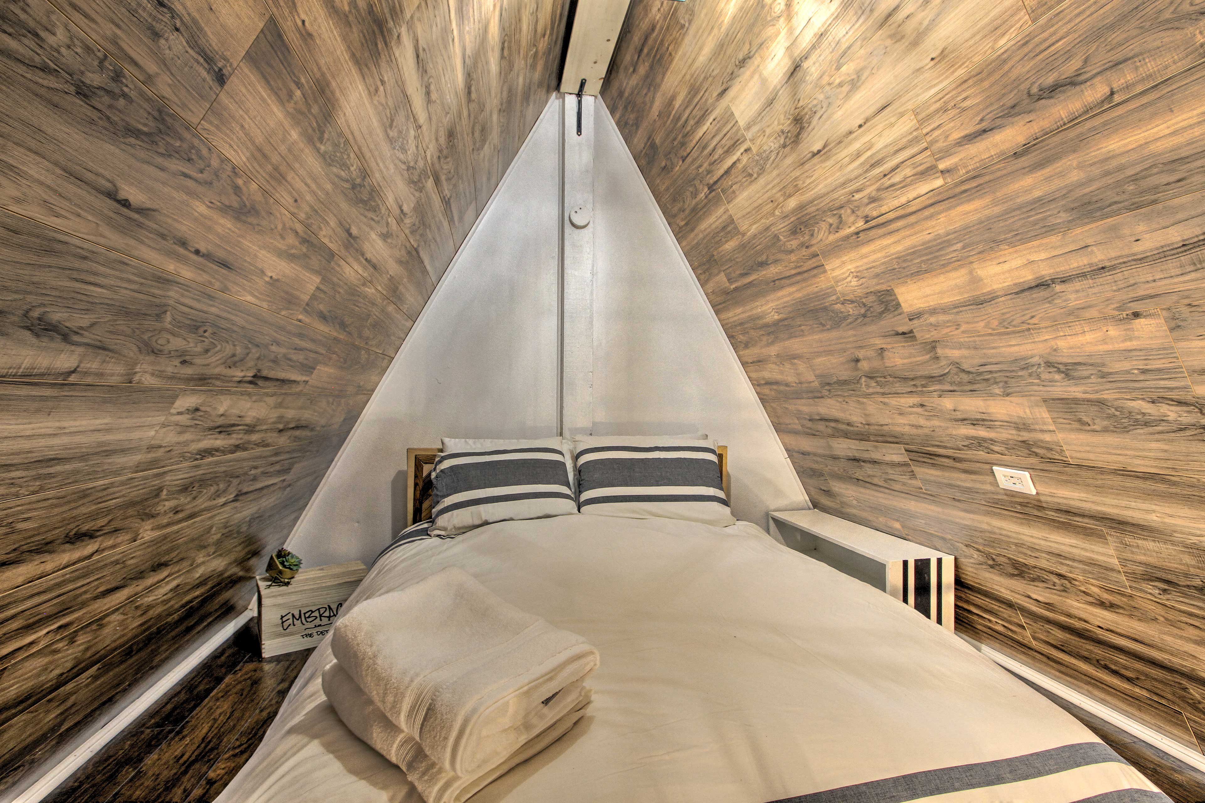Two guests can snooze in the cozy loft.