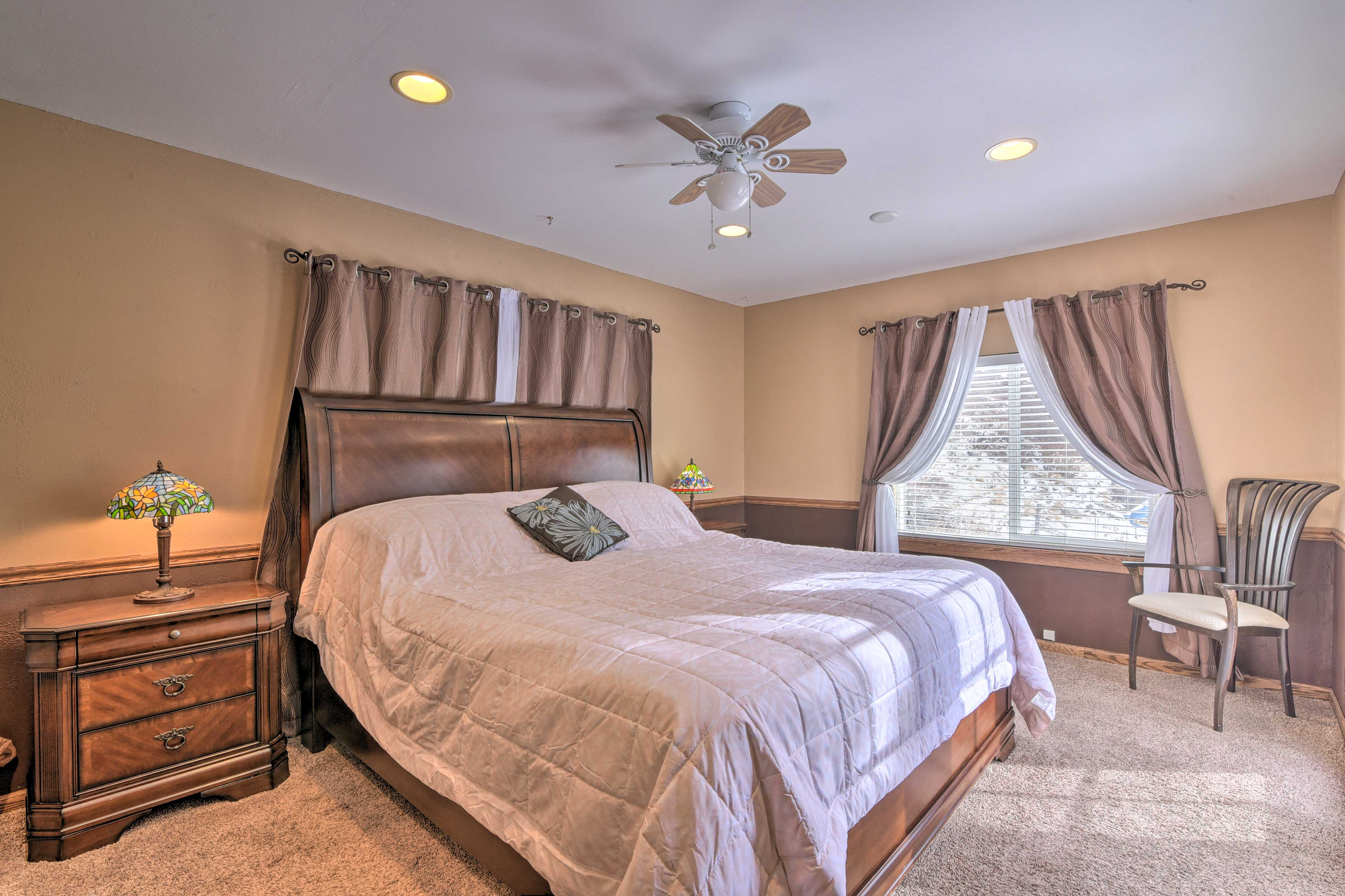 This bedroom sleeps 2 in a cozy king bed.