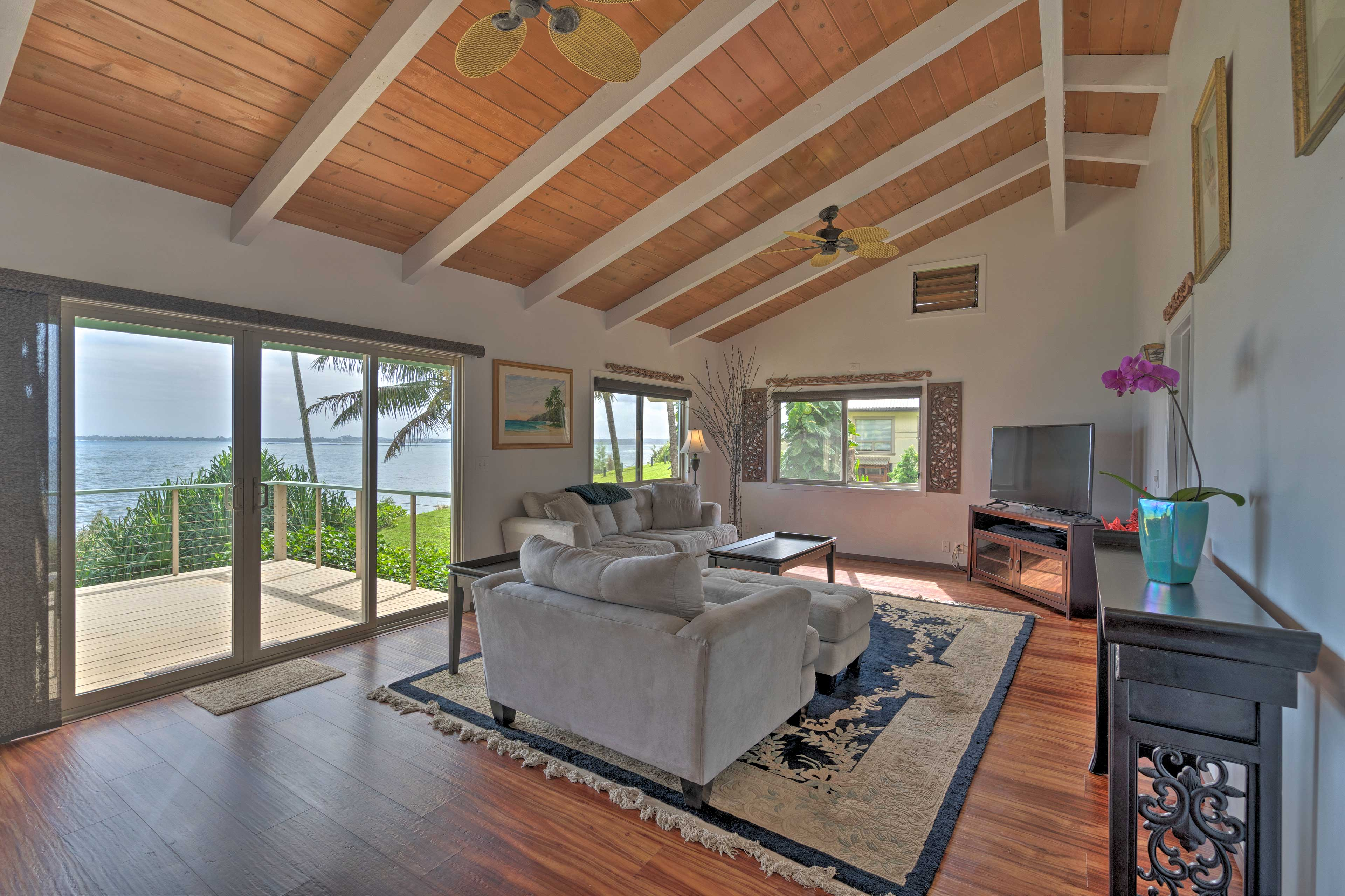 Wood accents and numerous windows set the stage for your Hawaiian getaway.
