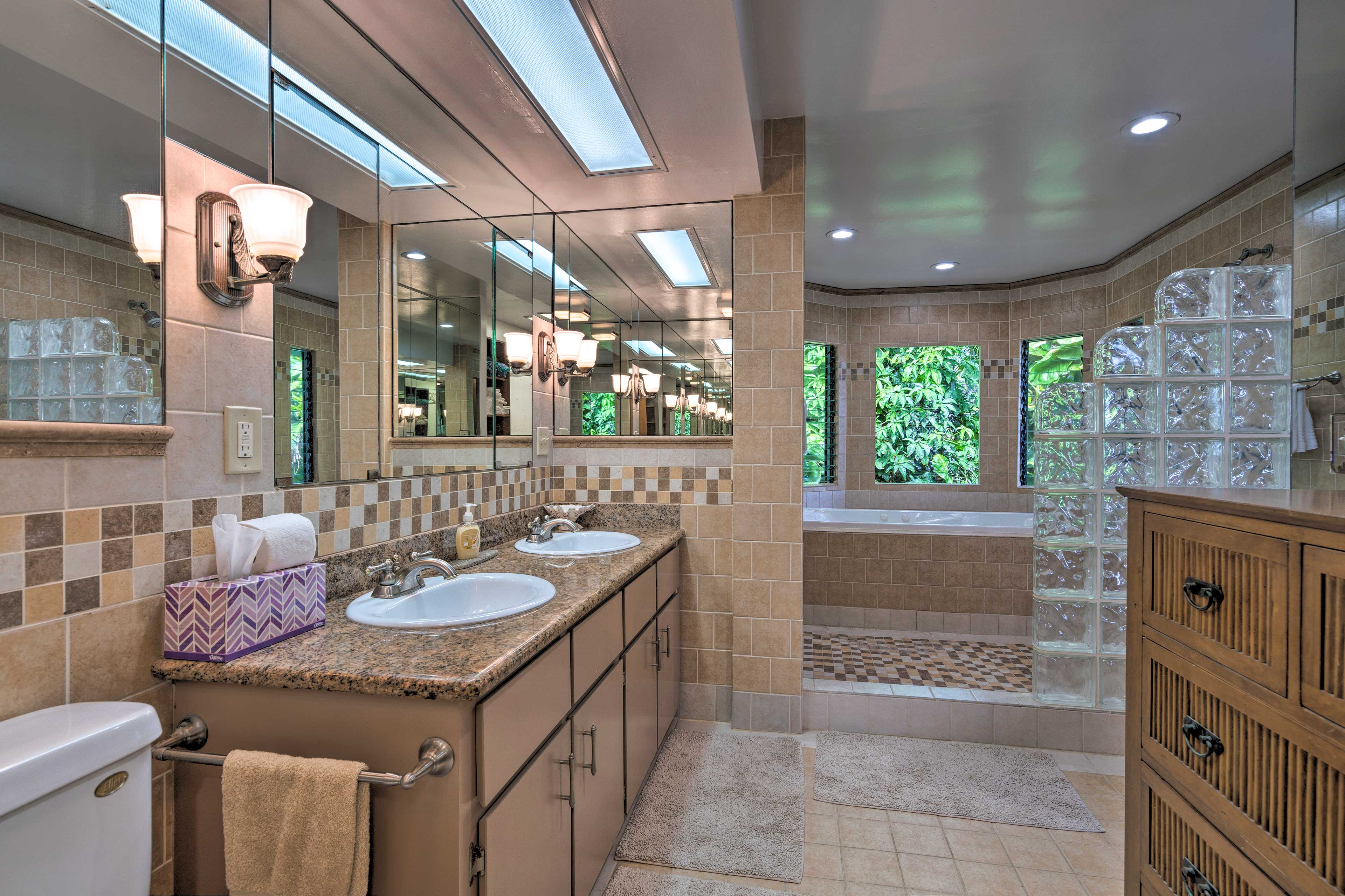 The master en-suite bathroom has plenty of room for all your toiletries.