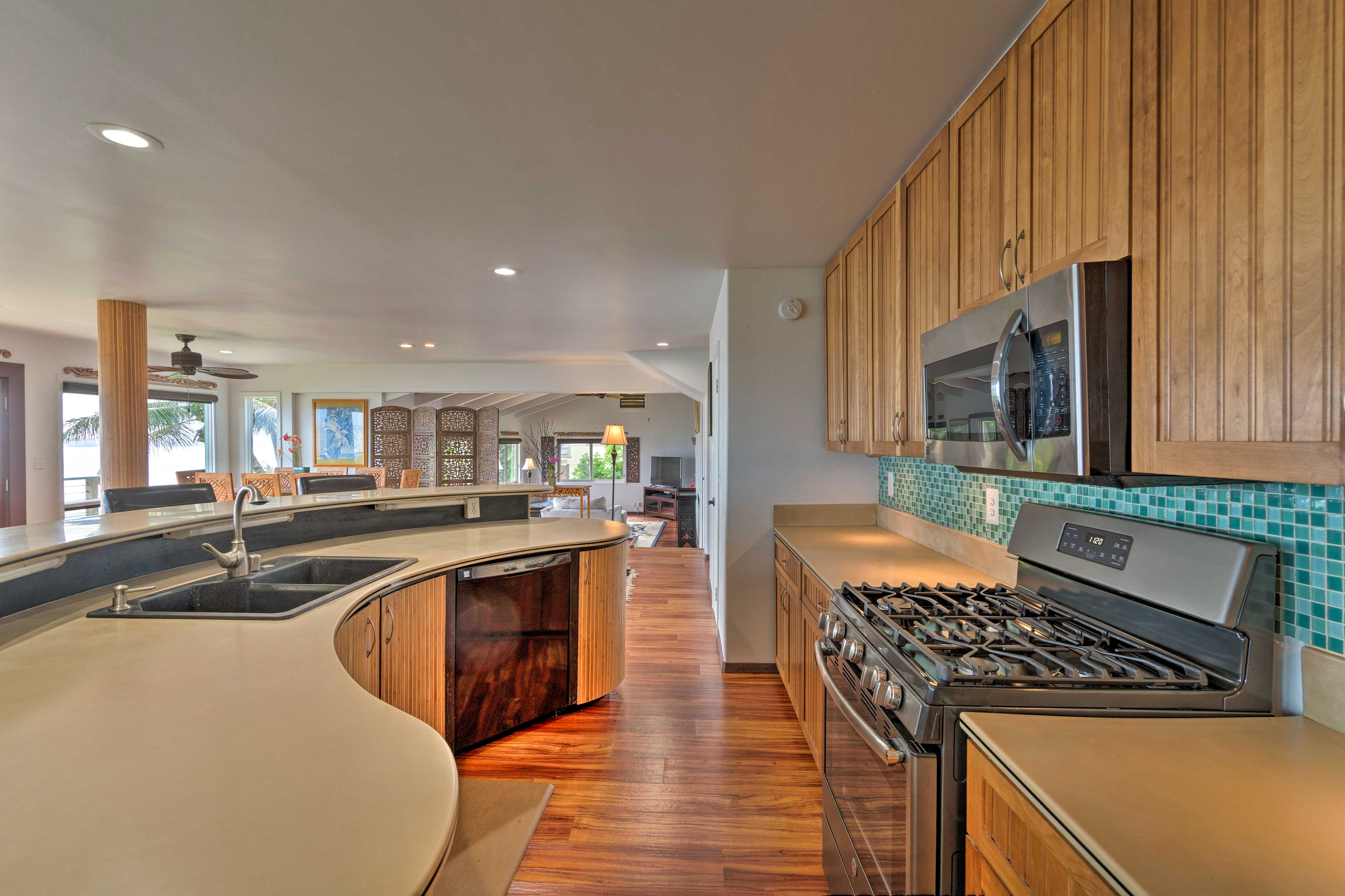 The fully equipped kitchen has stainless steel appliances and Corian counters.