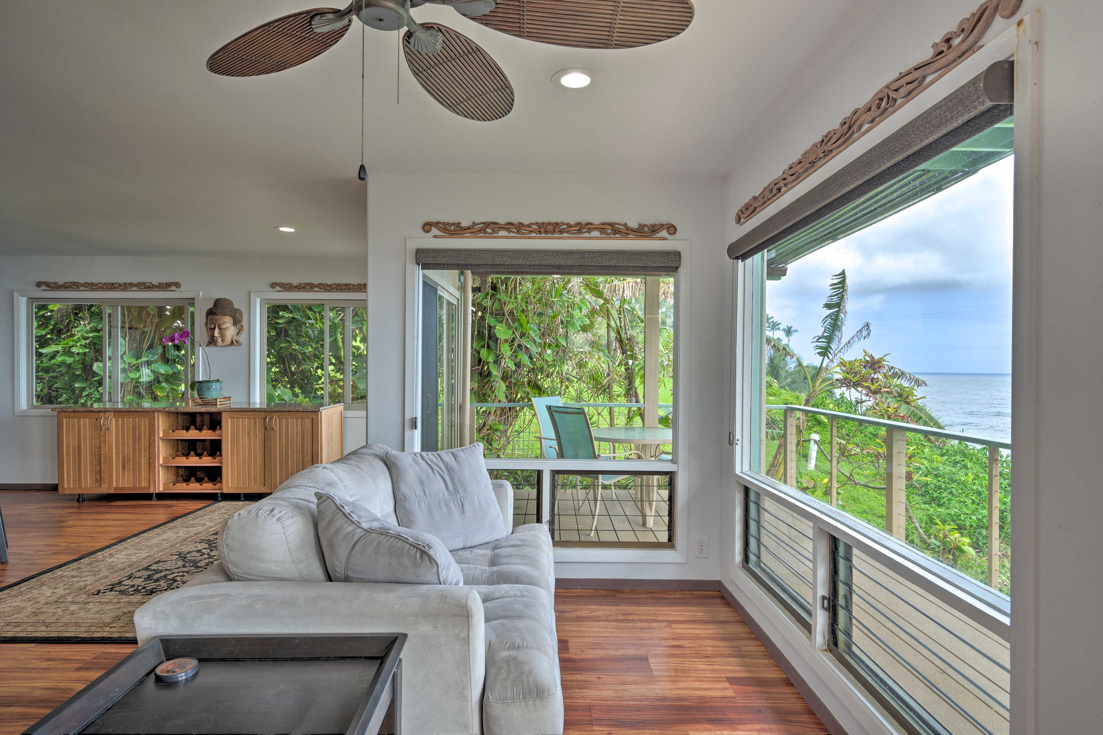 Enjoy an after dinner coffee on this sofa while looking out at the water.