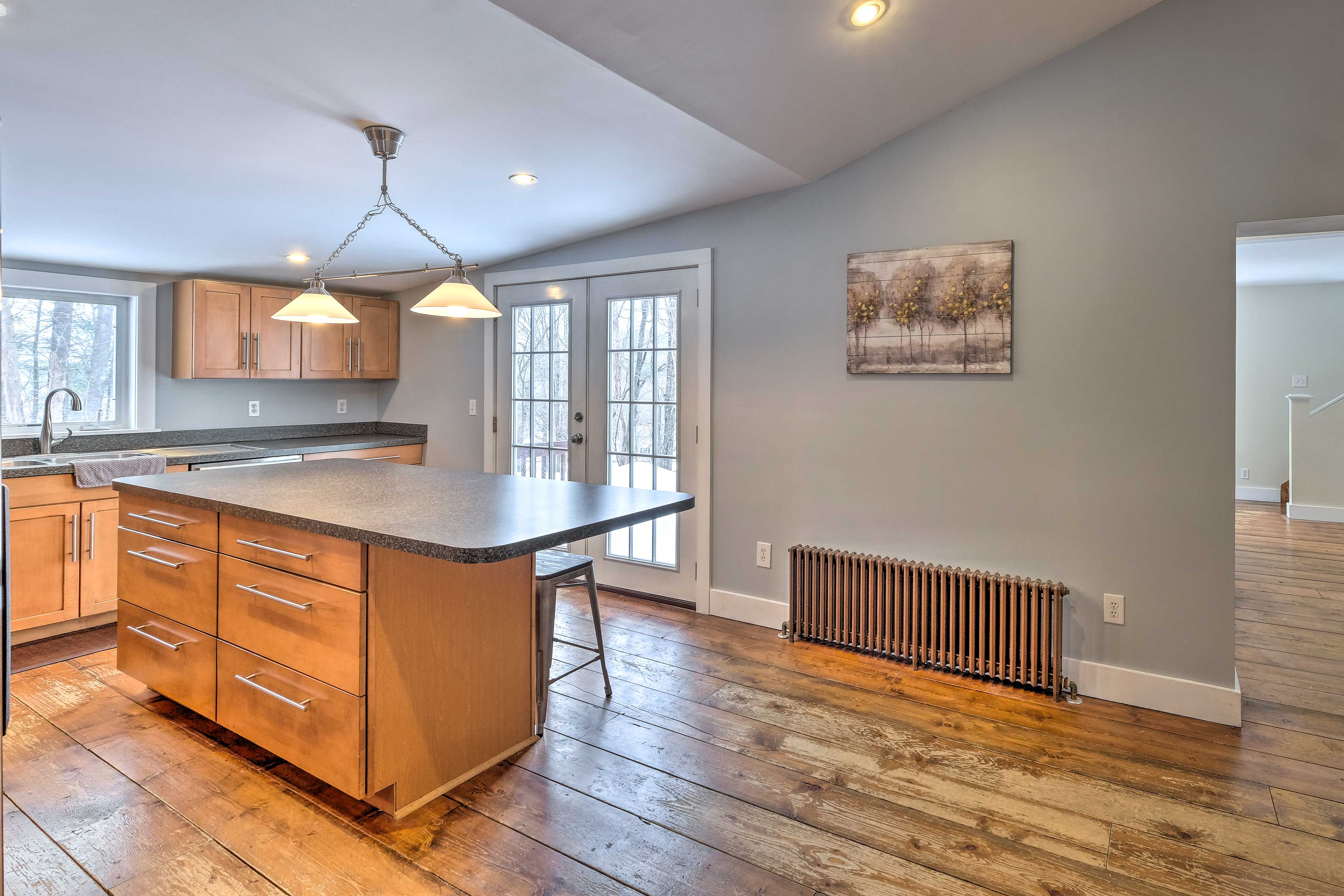 The spacious kitchen provides an island countertop, great for meal prepping!