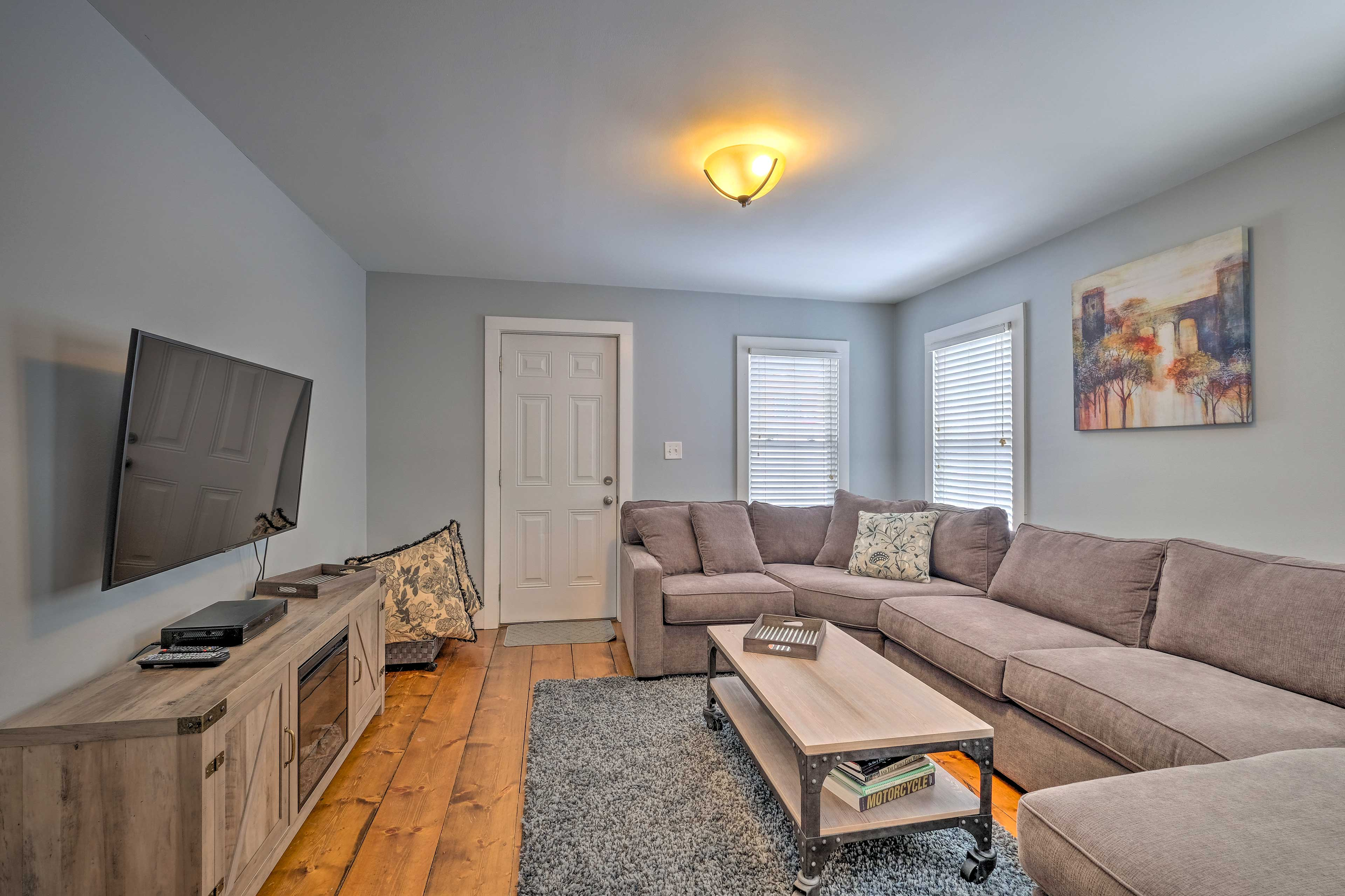 At-home amenities include a cozy living space, private yard, & furnished deck.