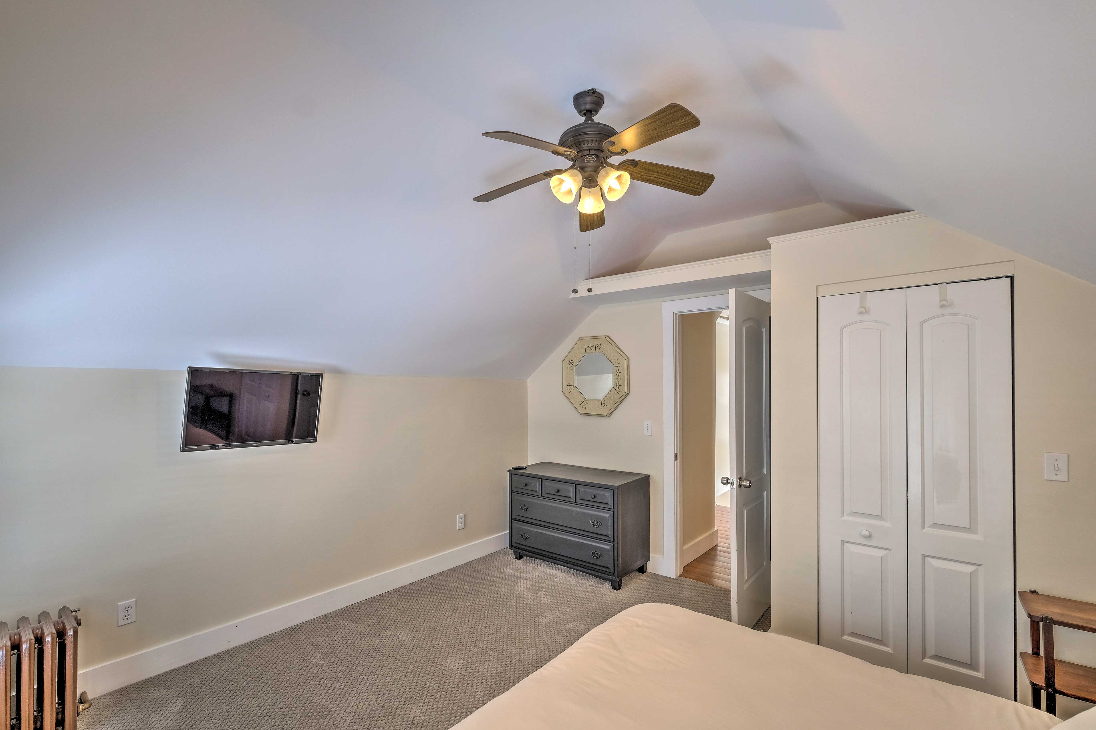 A mounted flat-screen TV provides in-bed entertainment at any time of day!