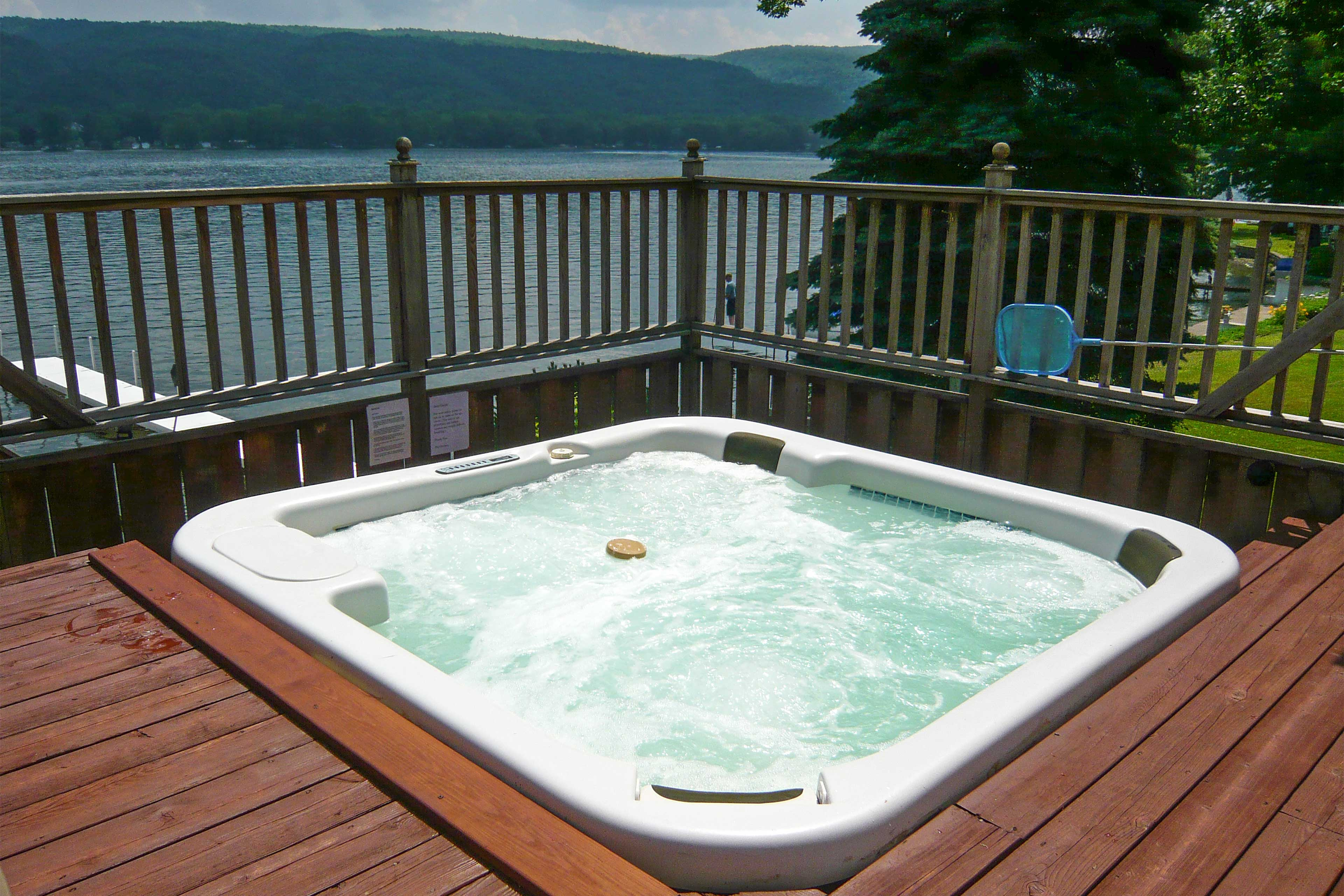 Soak in views of Honeoye Lake in your backyard from your private hot tub!