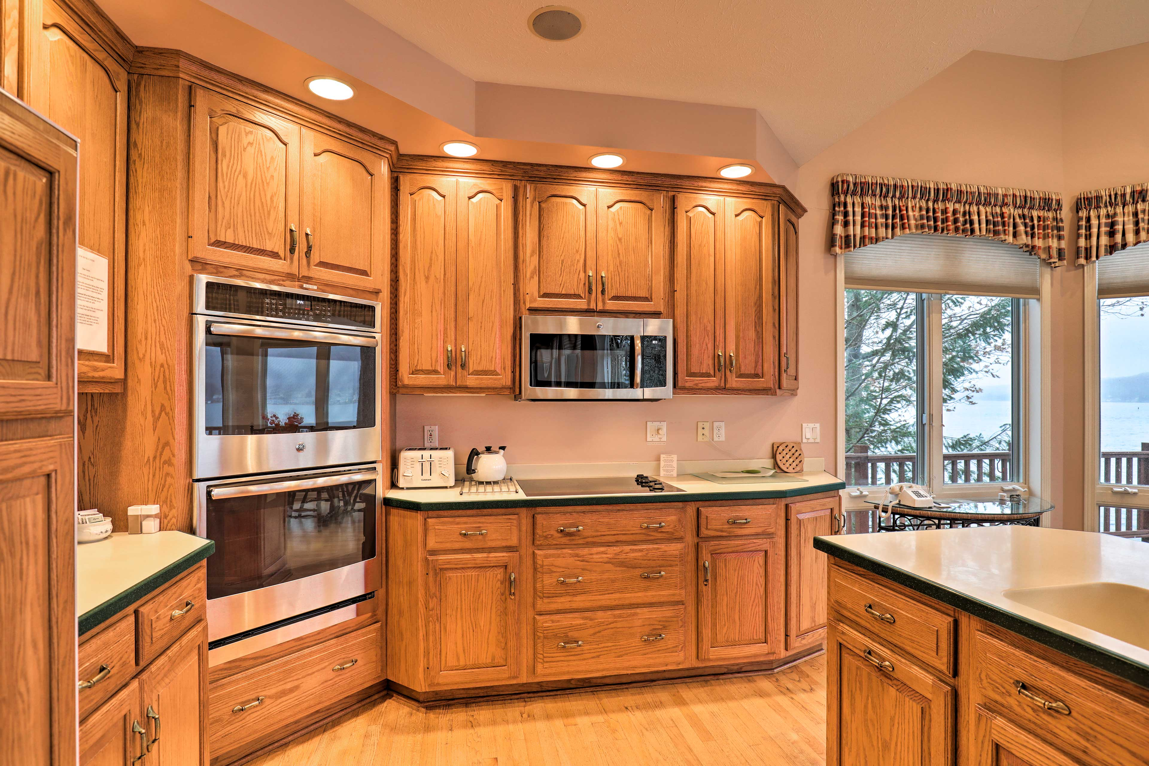 The wood-accented kitchen is fully equipped with modern appliances and cookware!