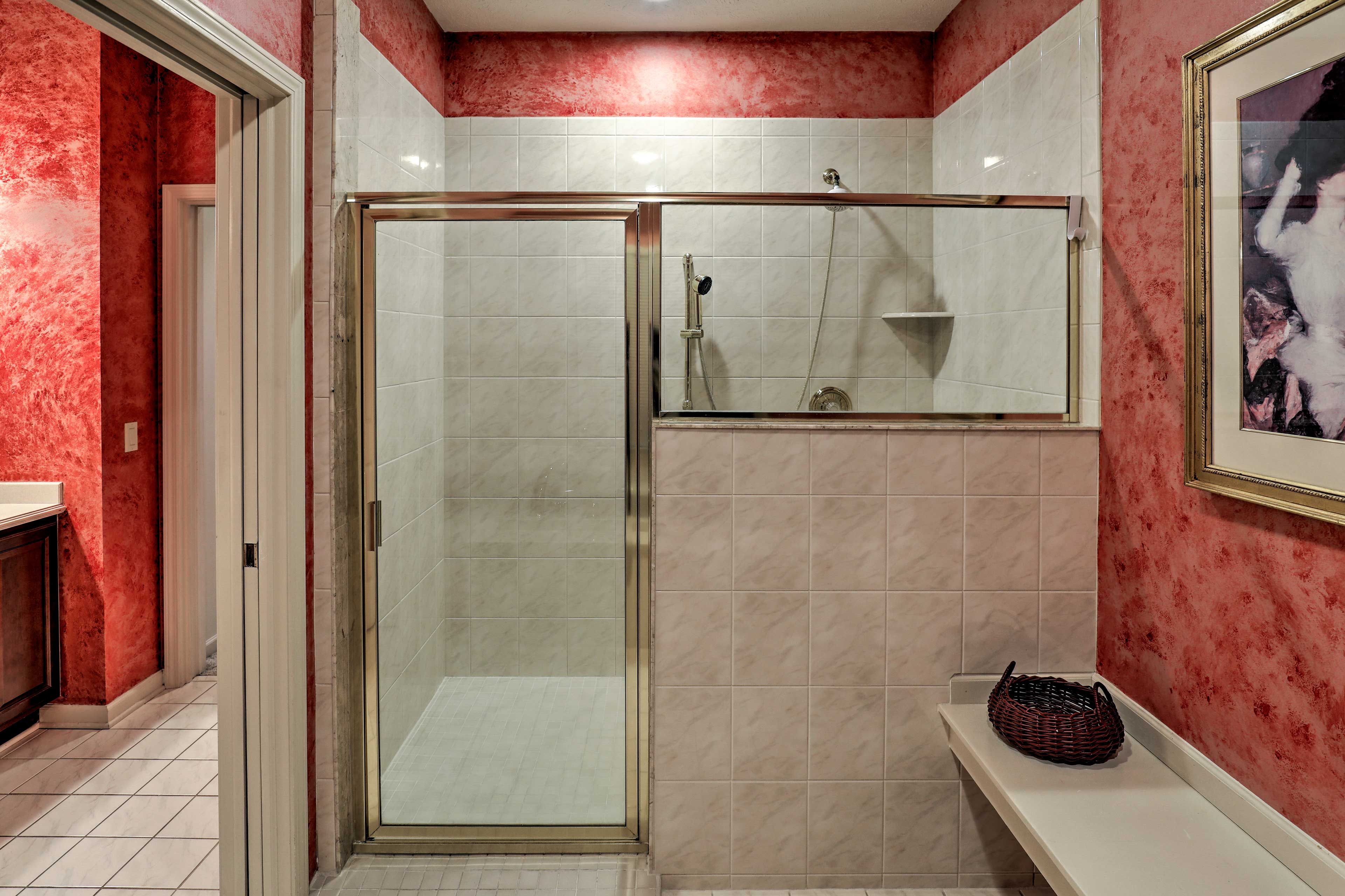 Rinse off quickly with this spacious walk-in shower.