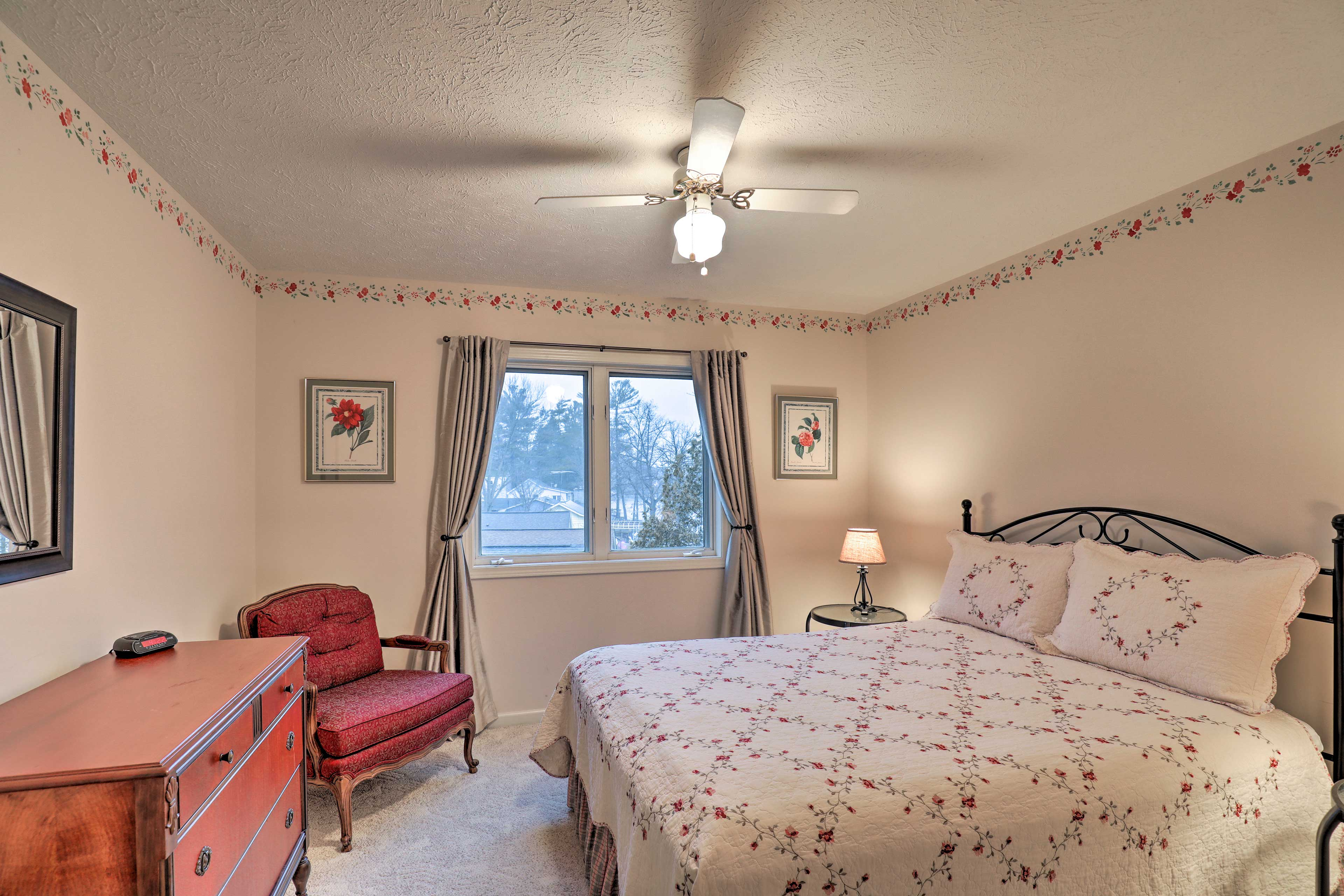 You'll get a great night of rest in this comfortable bedroom with floral decor.