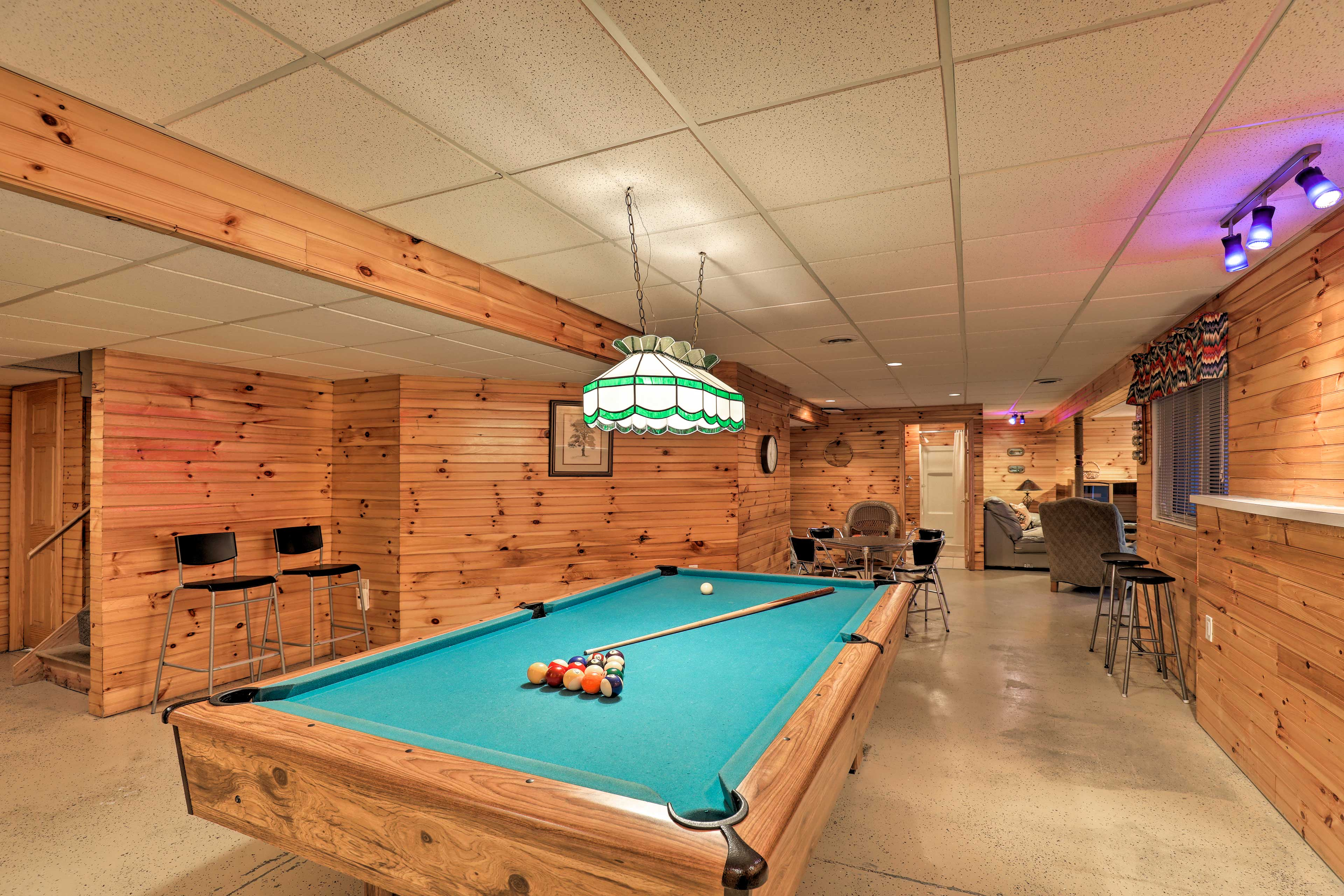 Let your competitive spirit shine with a game of pool in the game room!