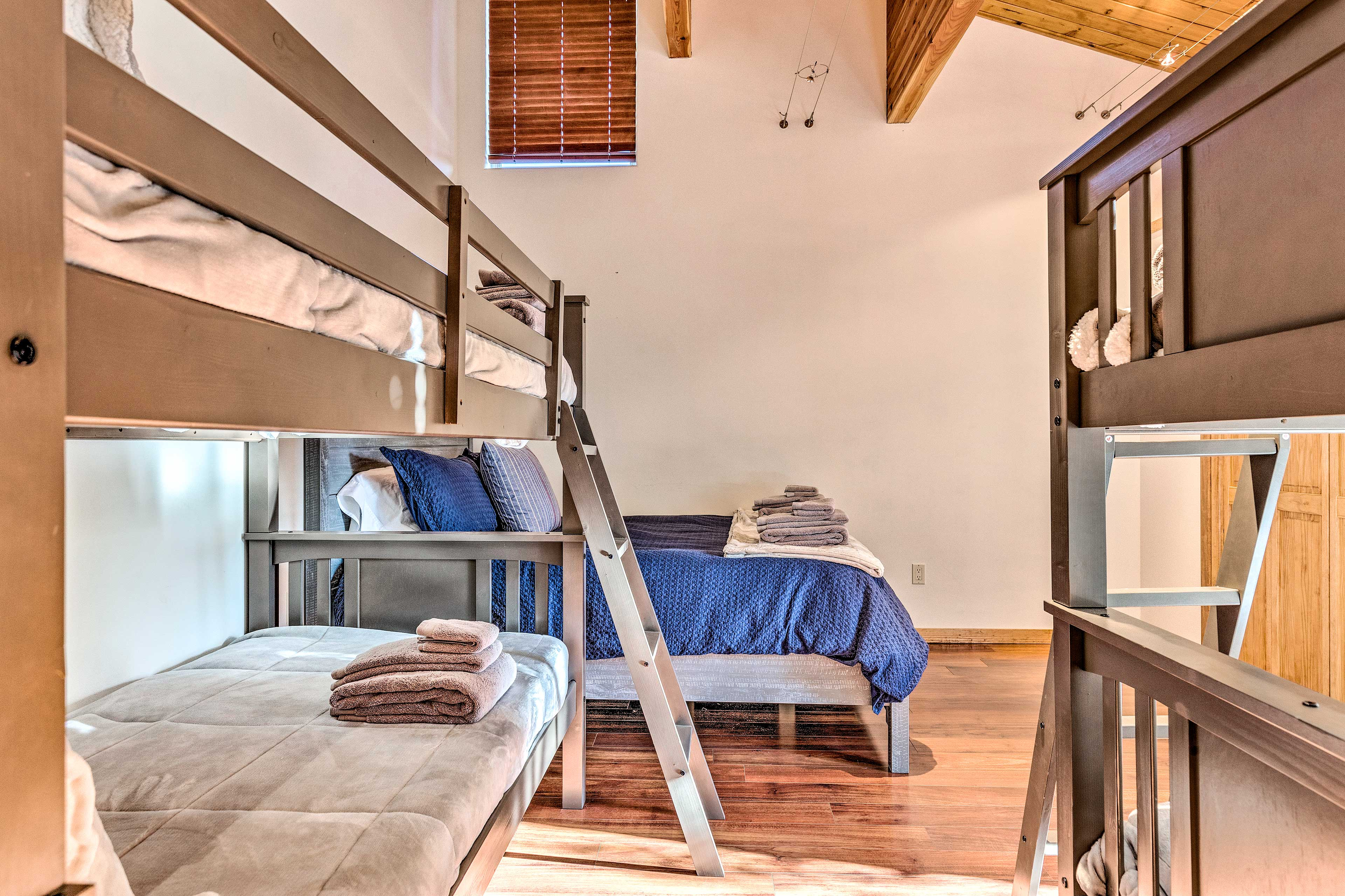 This room features a queen bed and bunk beds.