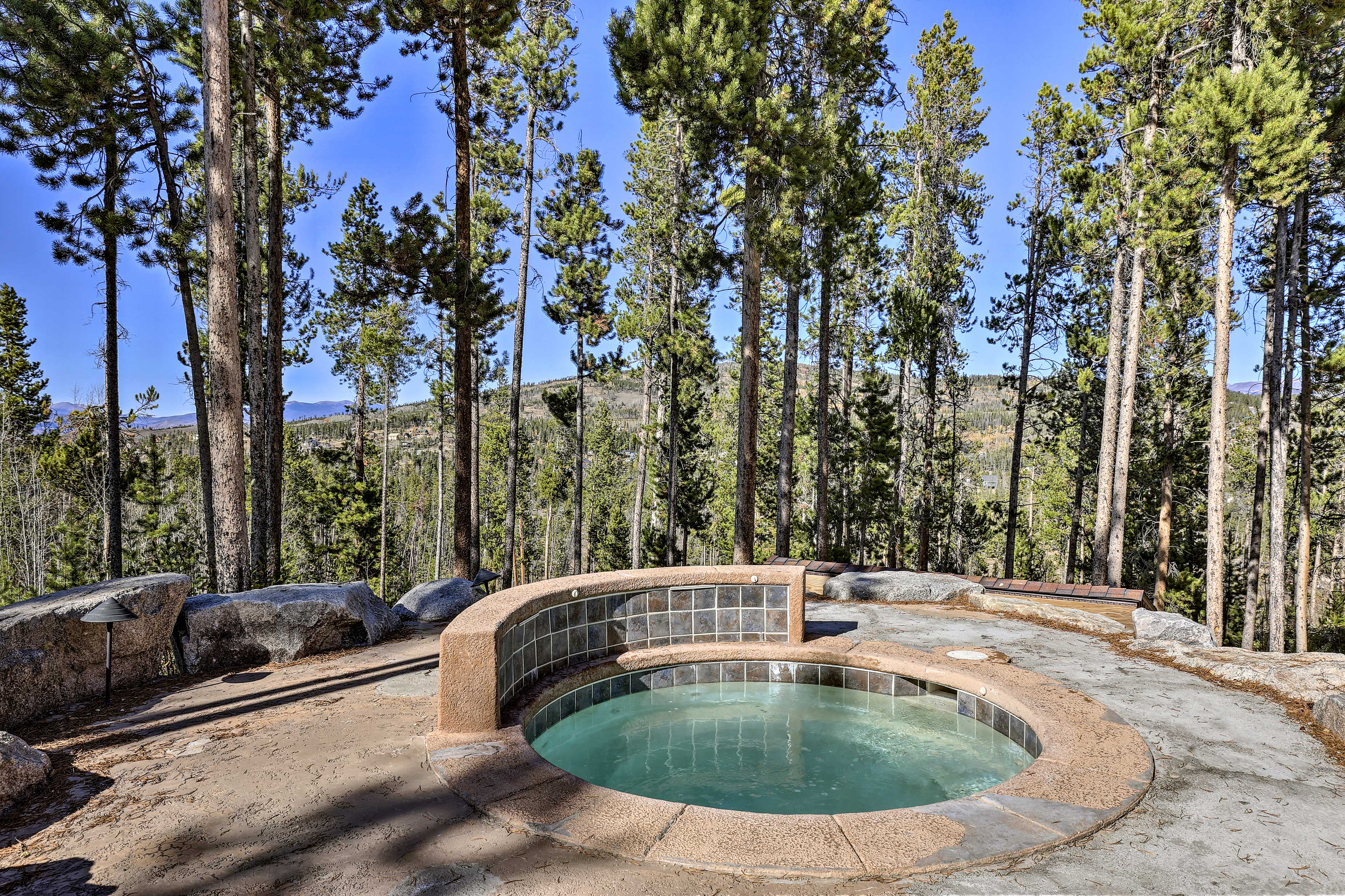 Enjoy mountain views from your private, in-ground hot tub.