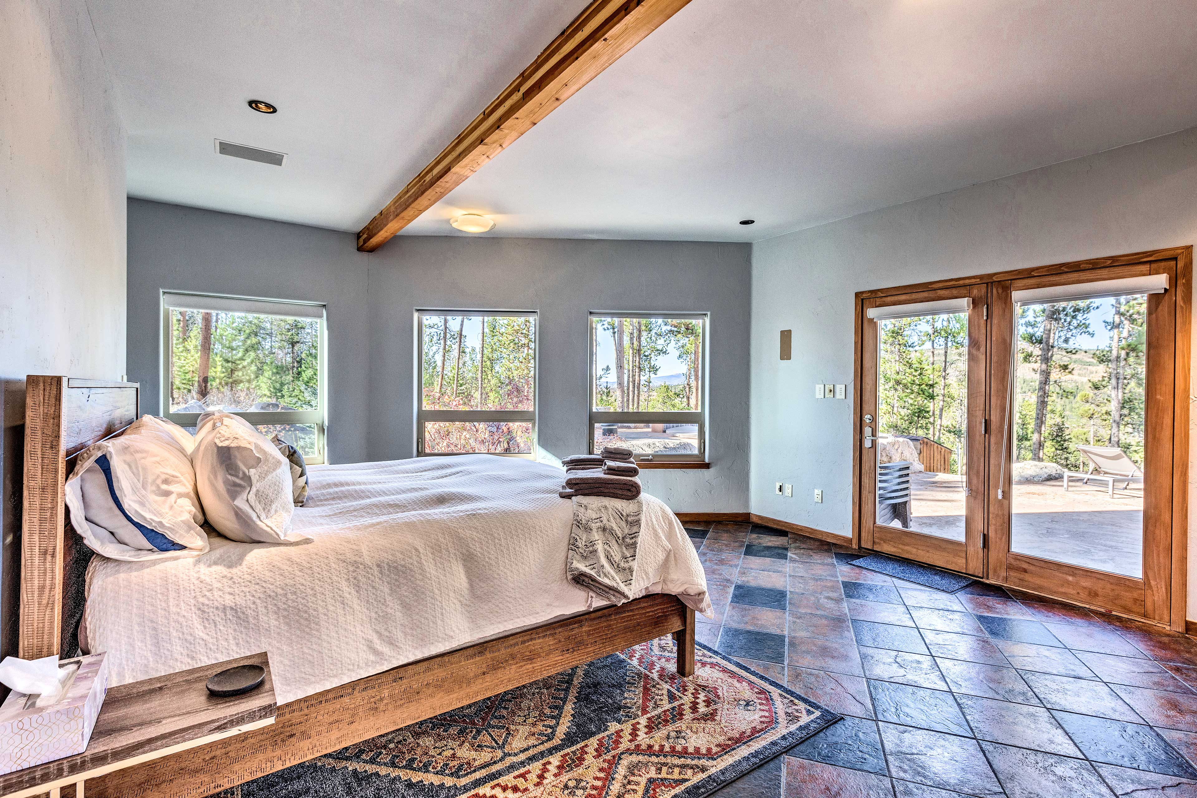 The spacious master bedroom boasts a king-sized bed.