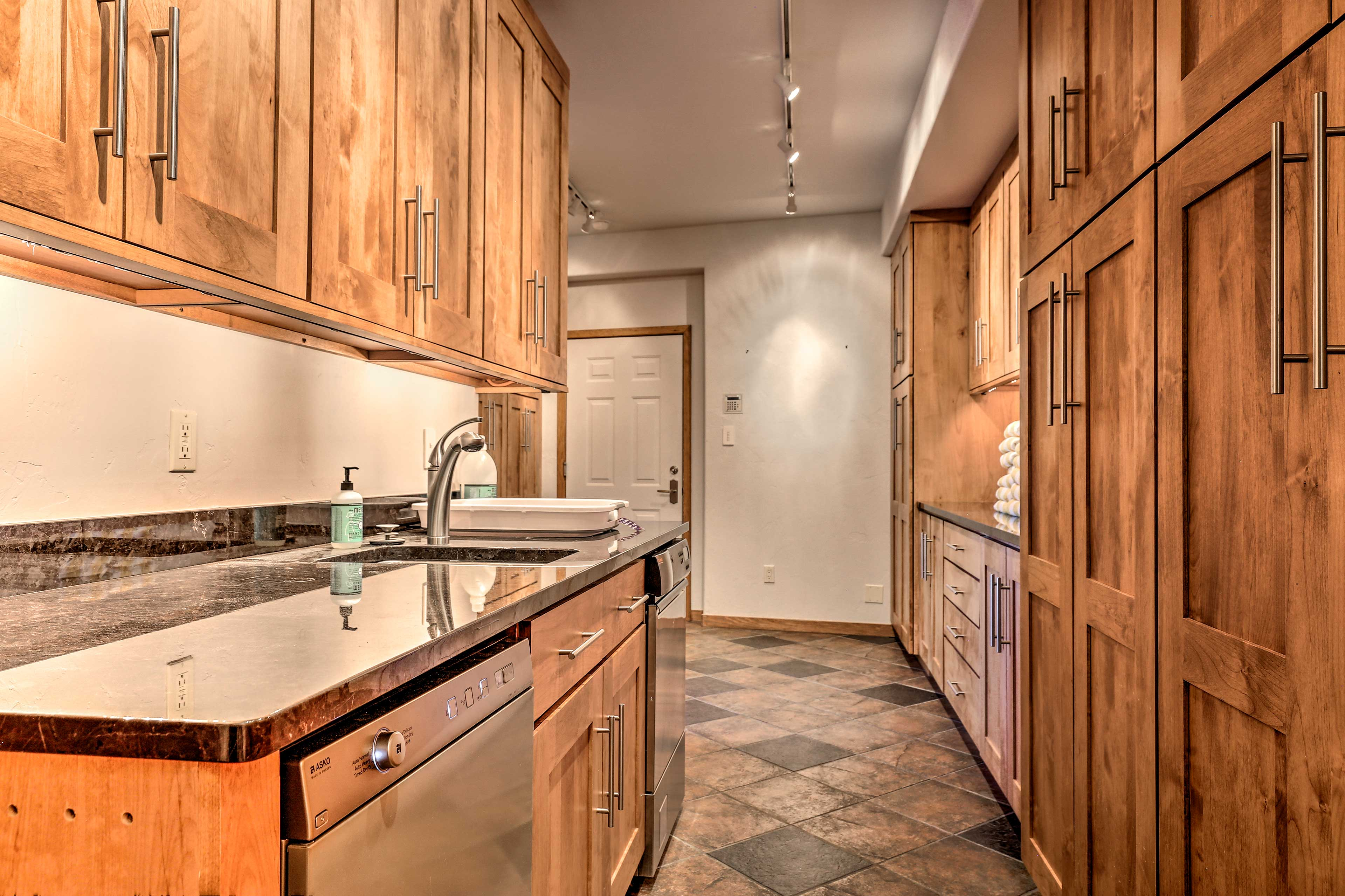 The downstairs wet bar adds convenience to your stay.