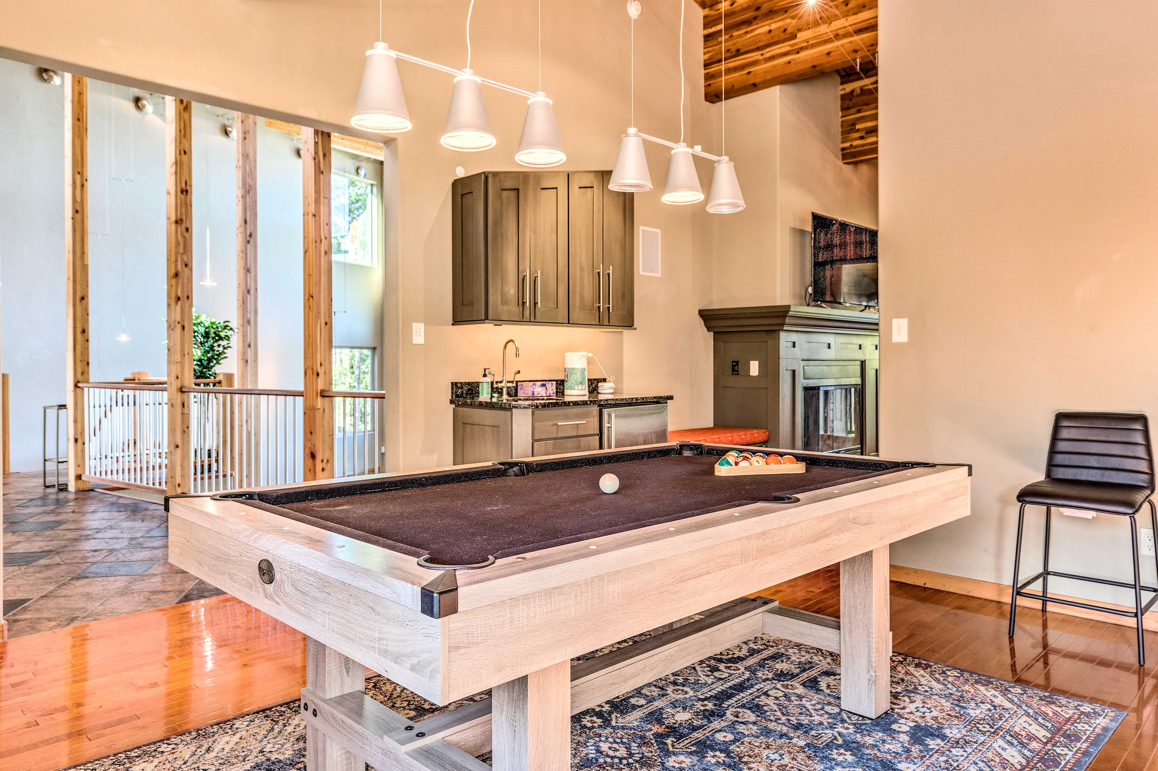 The pool table is a brand new addition to the property.