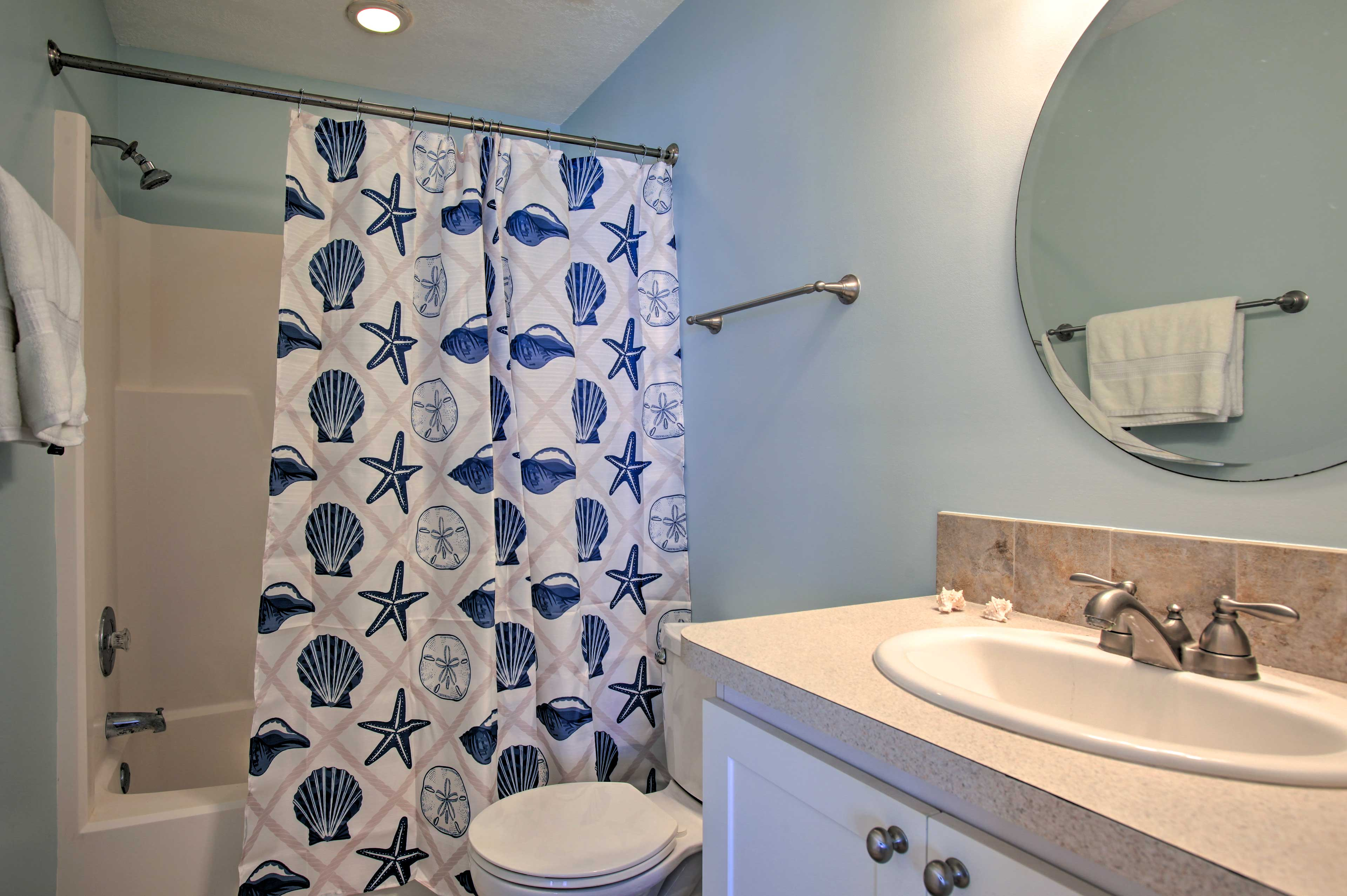 Rinse off in the shower/tub combo behind the seashell curtain.