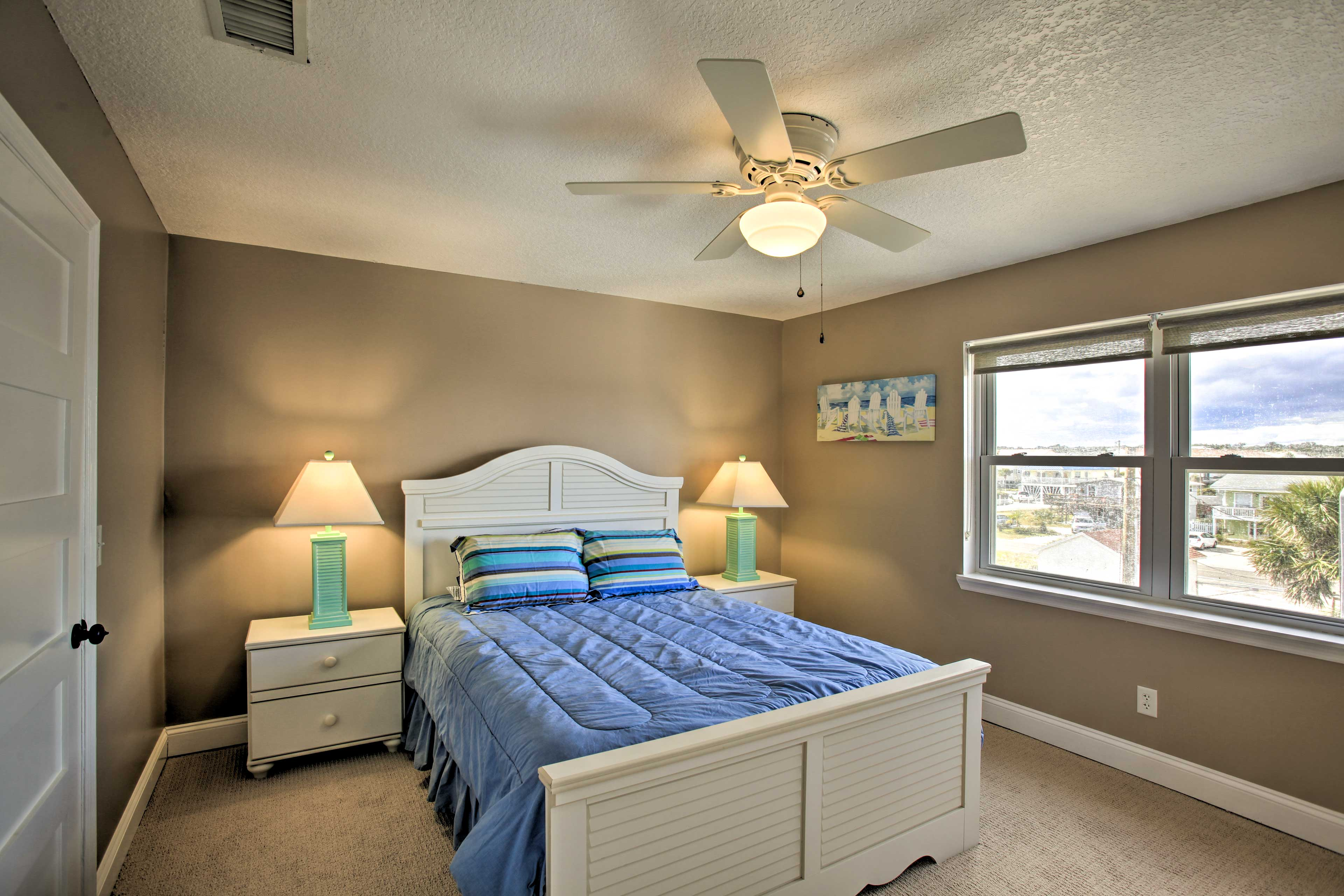 The second bedroom also offers a queen bed.