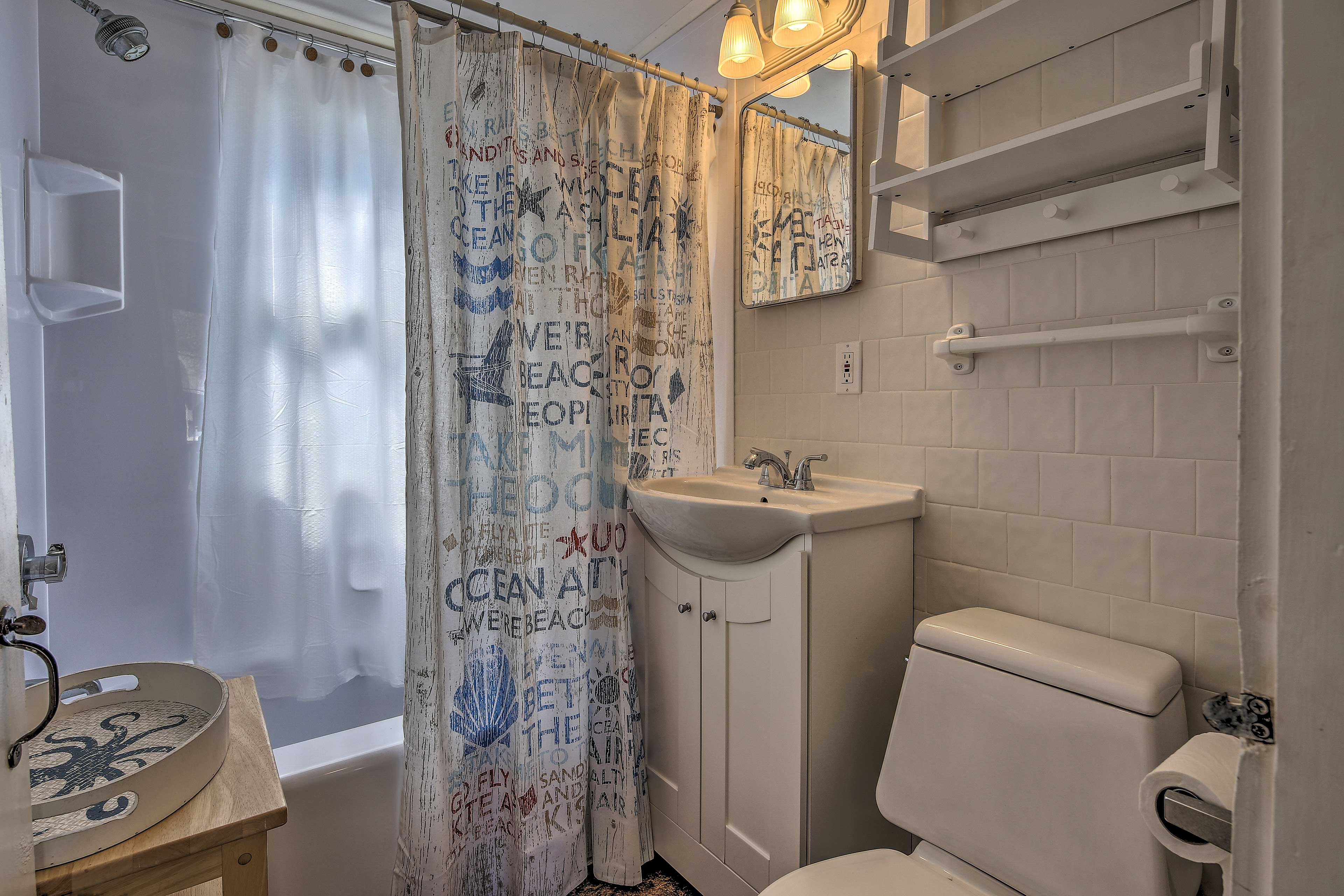 Rinse away the day in this full bathroom.