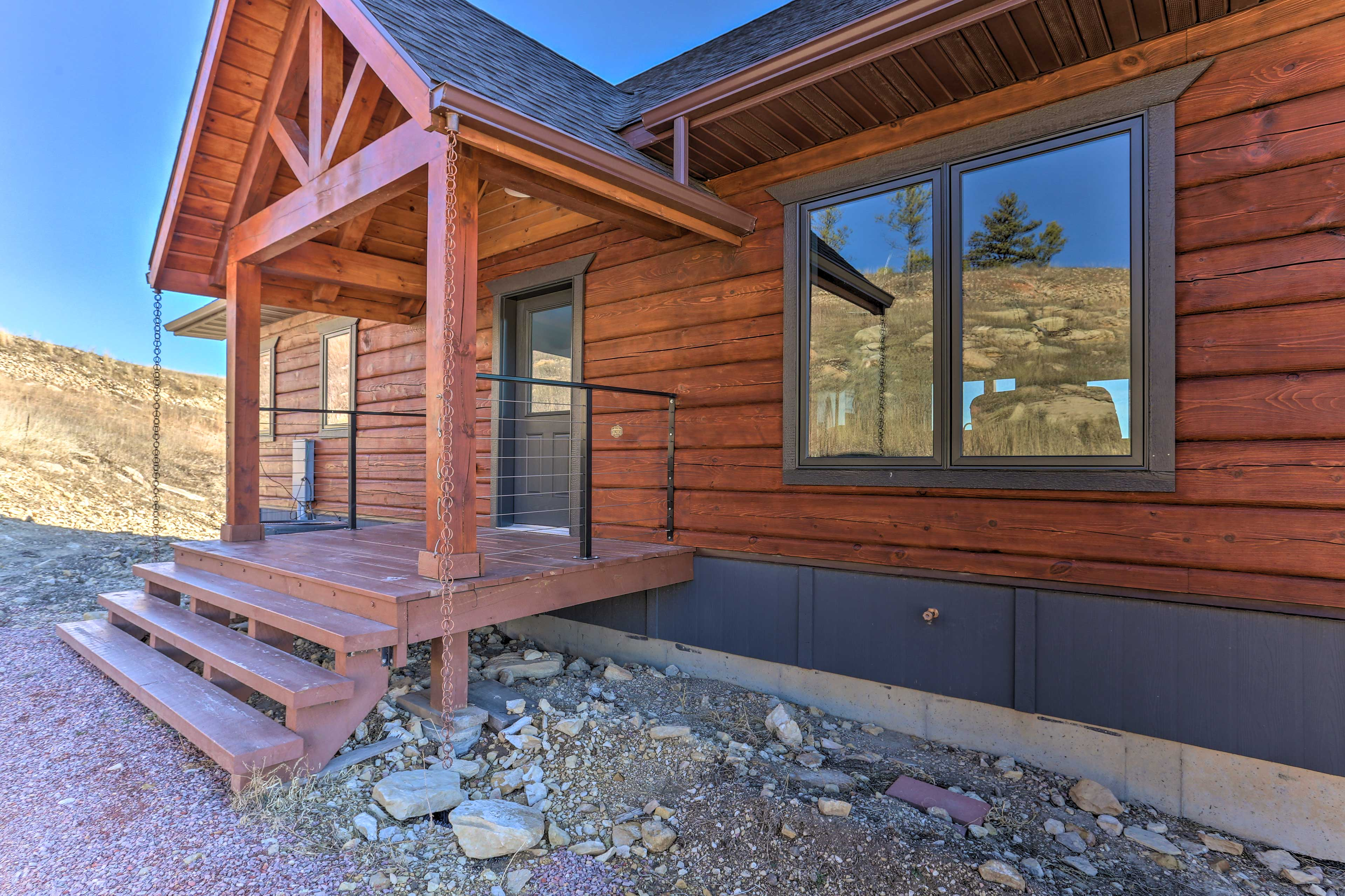 This charming cabin is set in a peaceful Black Hills setting.