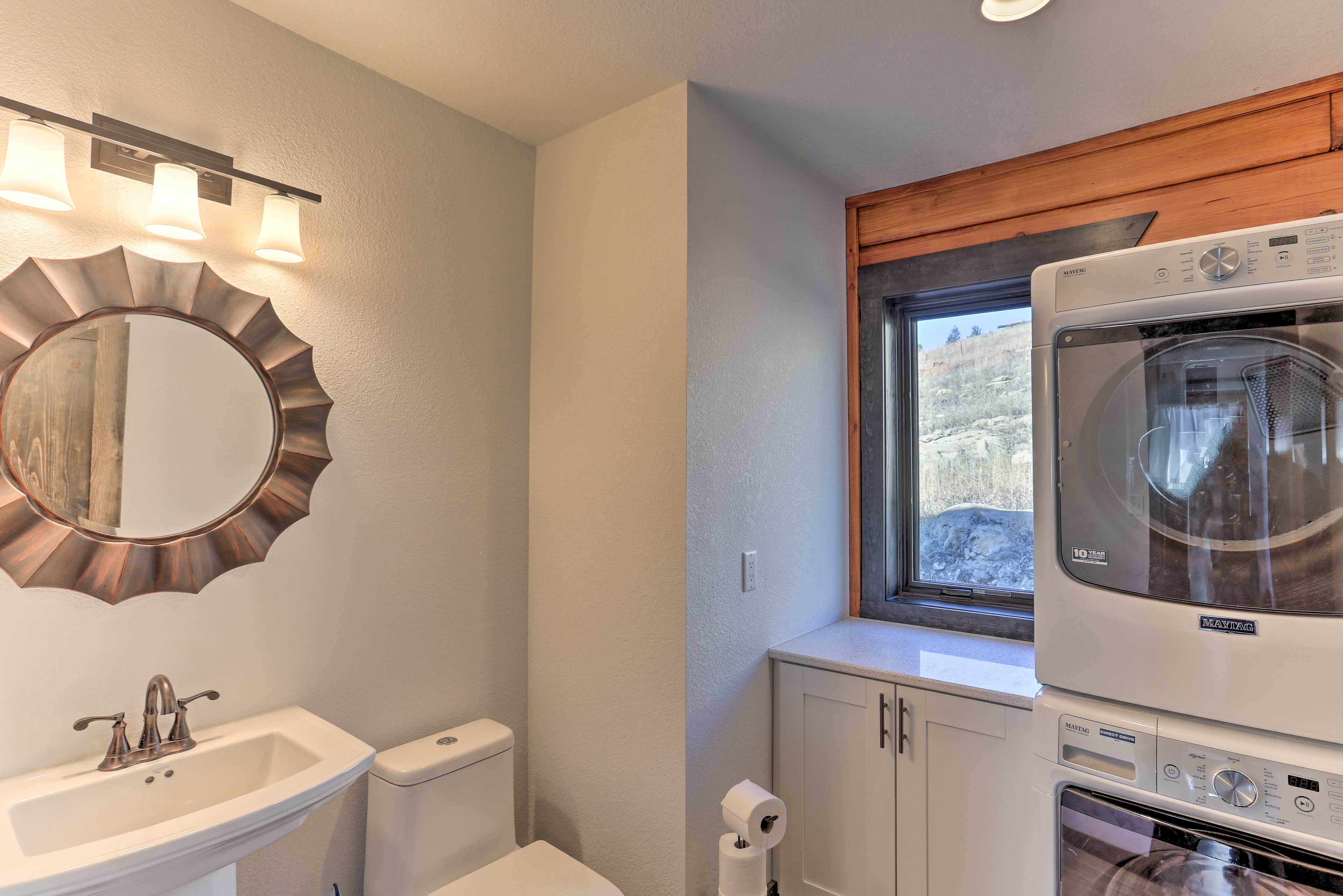 This half bathroom also serves as a laundry room!