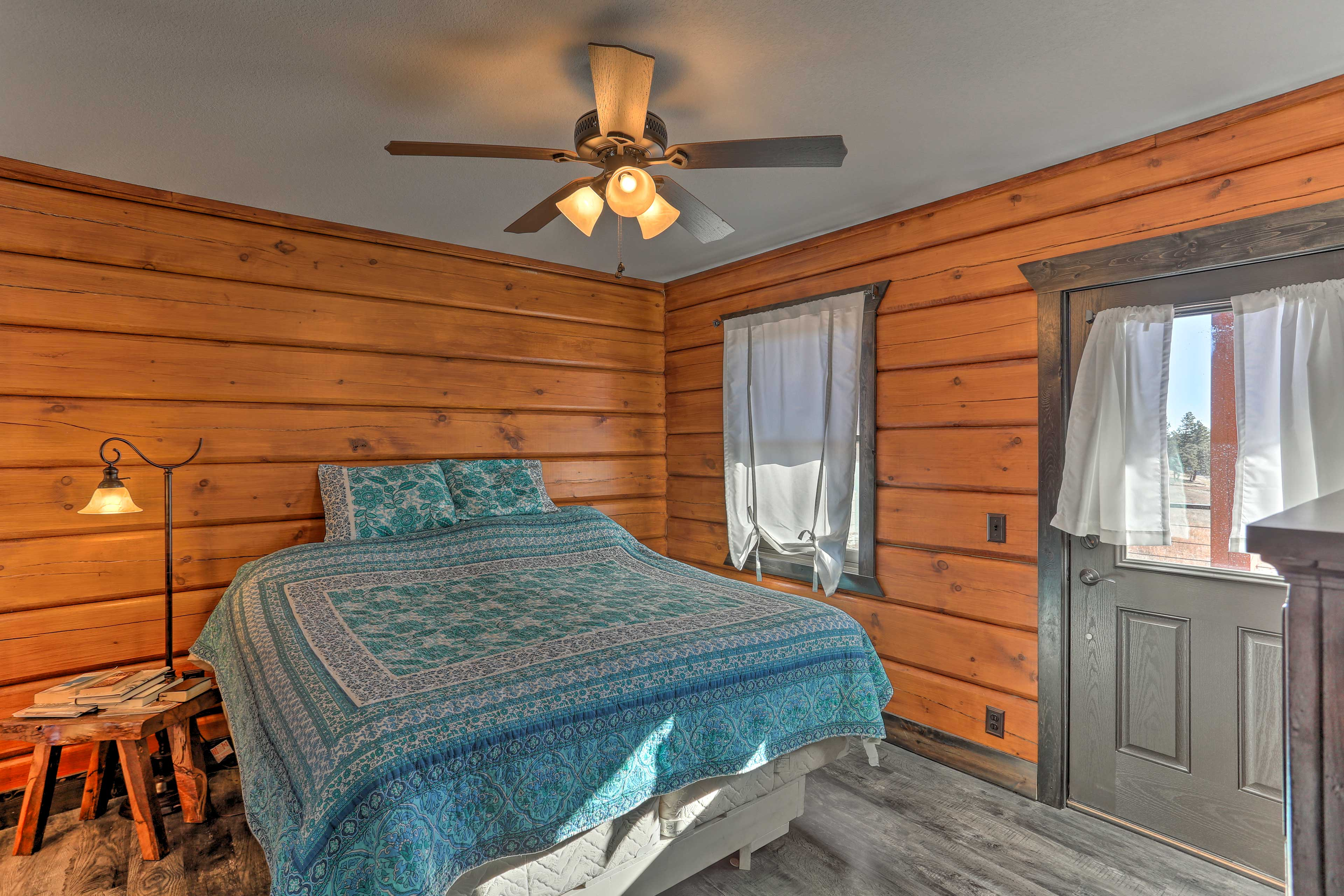 The second bedroom hosts a plush king bed.