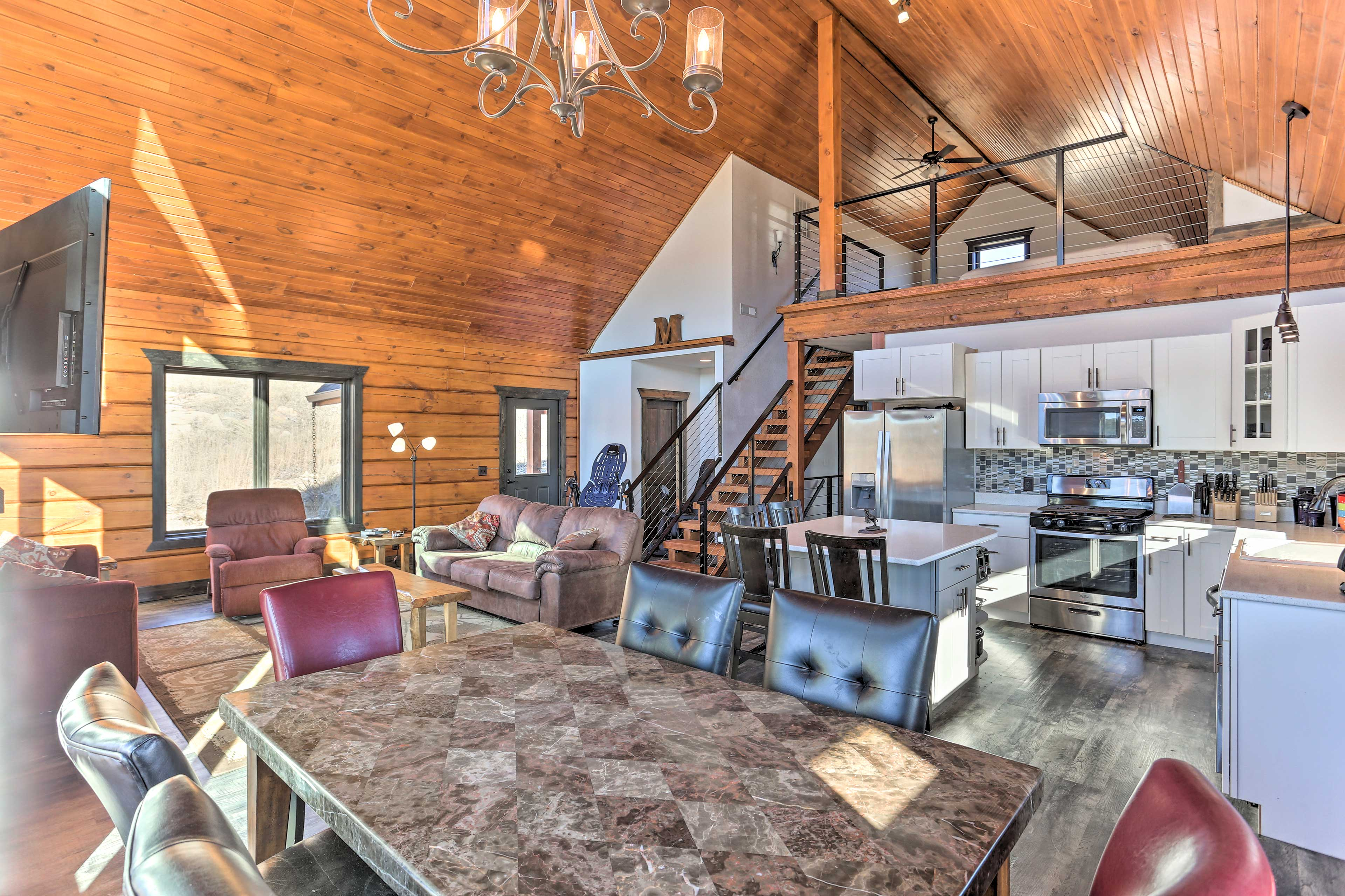 Vaulted wooden ceilings extend over the open concept space.