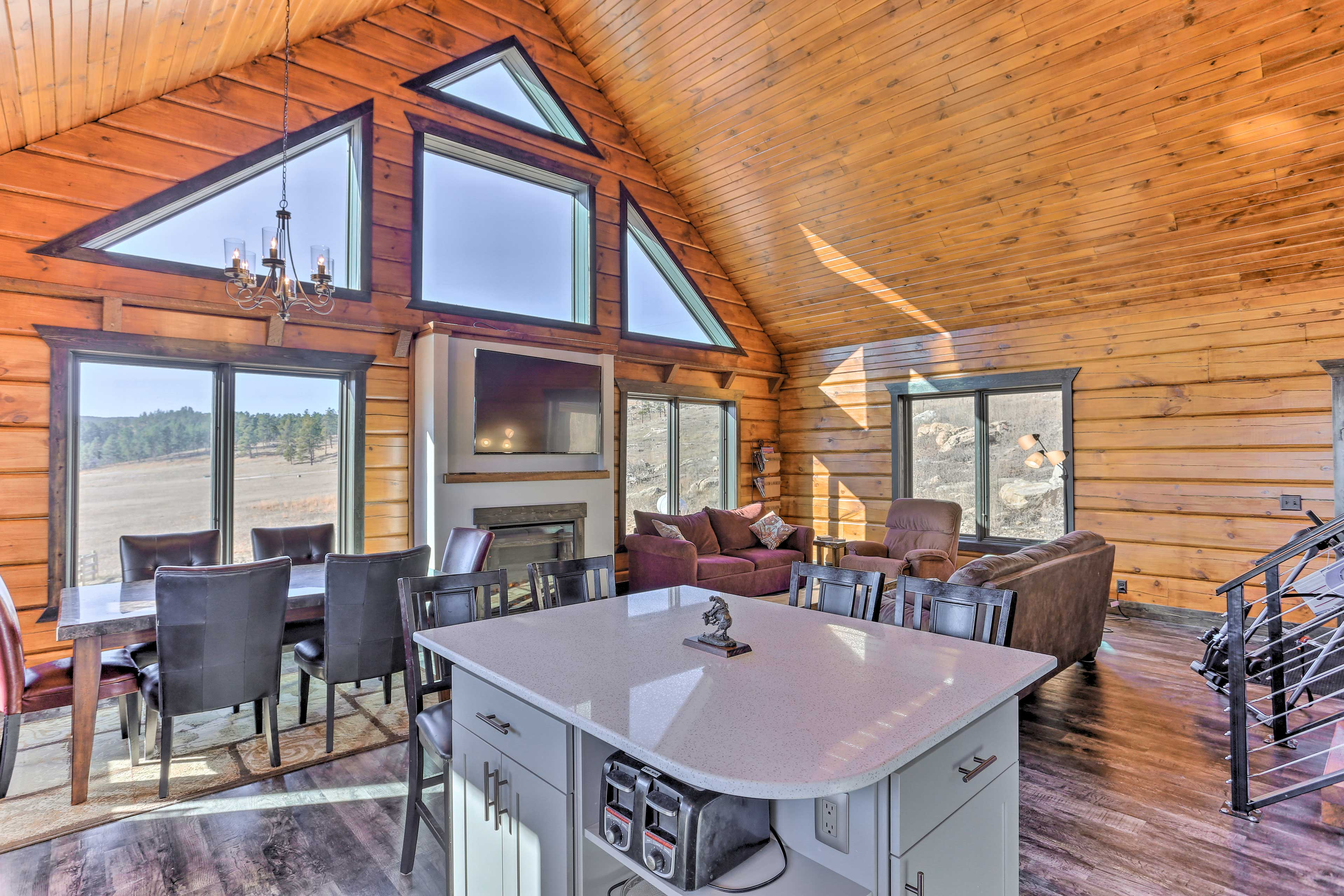 Dine at the 6-person table, or stay cozy with the electric fireplace.