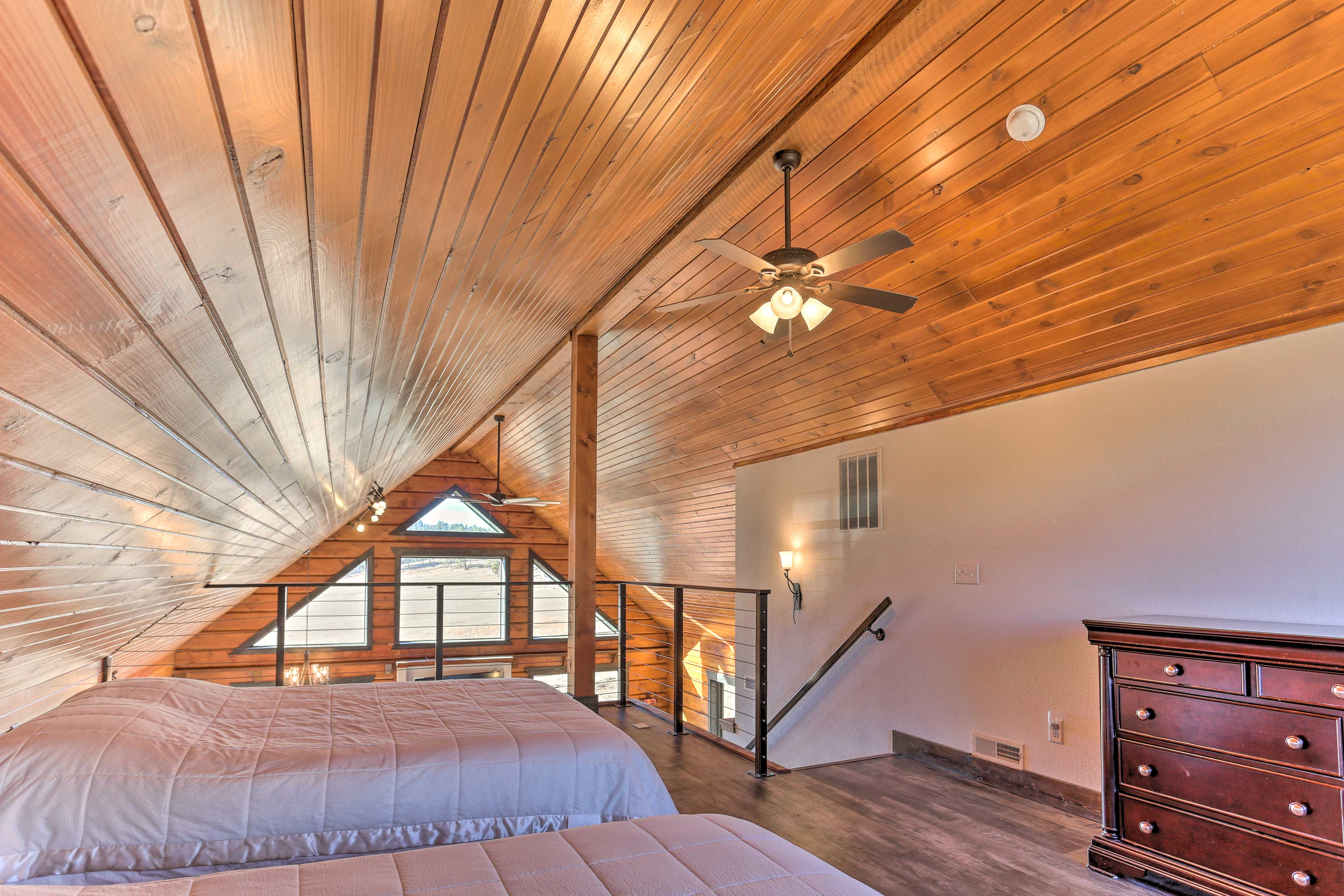 Upstairs, the loft boasts 2 queen beds.