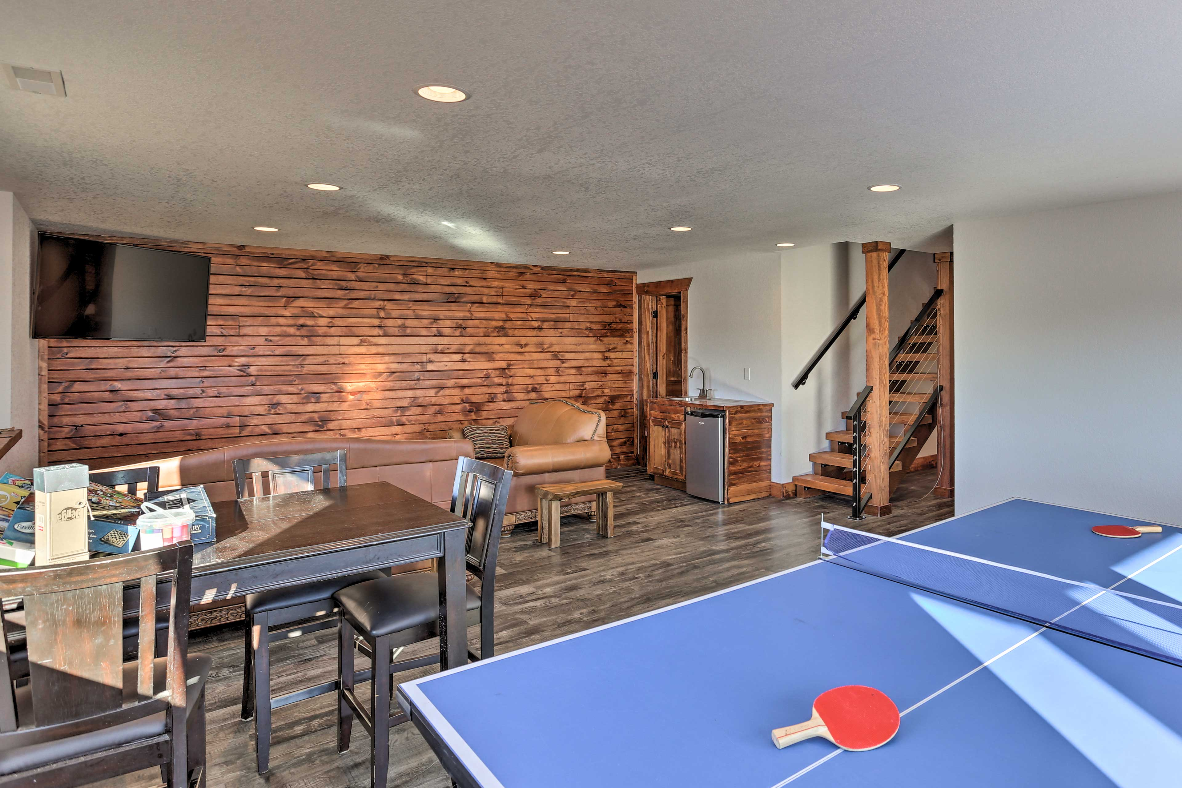 Downstairs, you'll find a separate lounge area with a ping pong table!