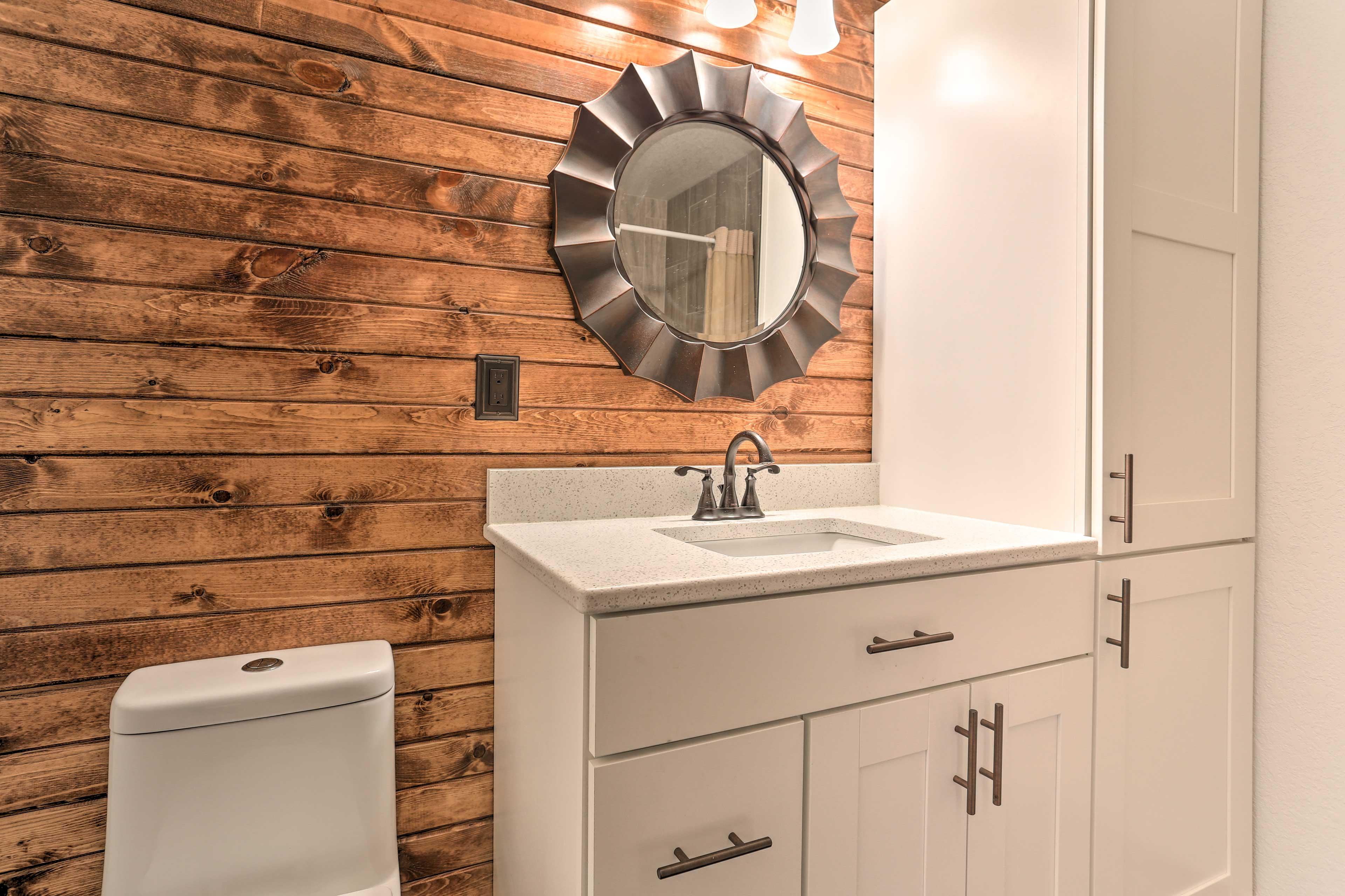 This full bathroom offers plenty of storage space.