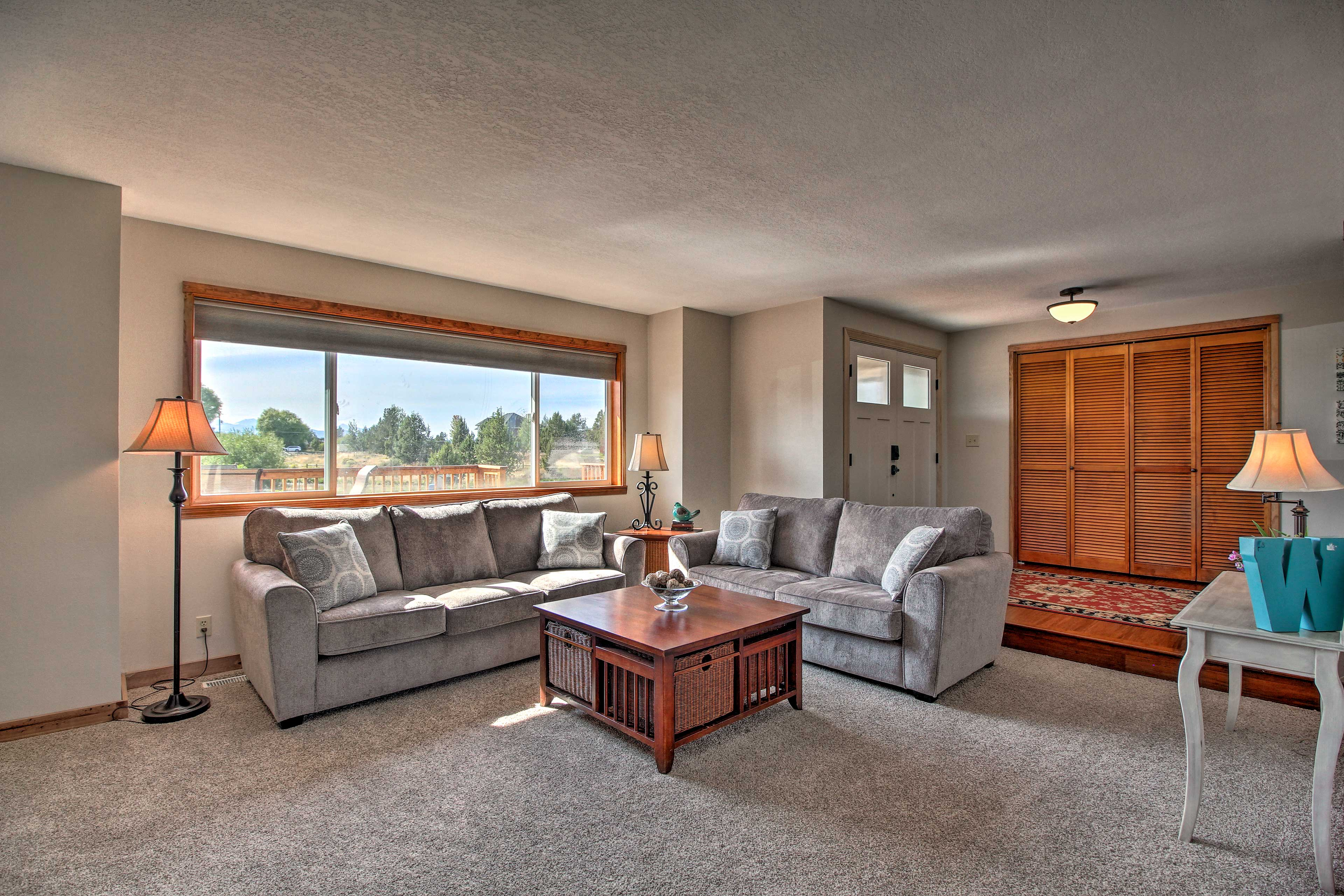 Natural light pours through large picture windows.