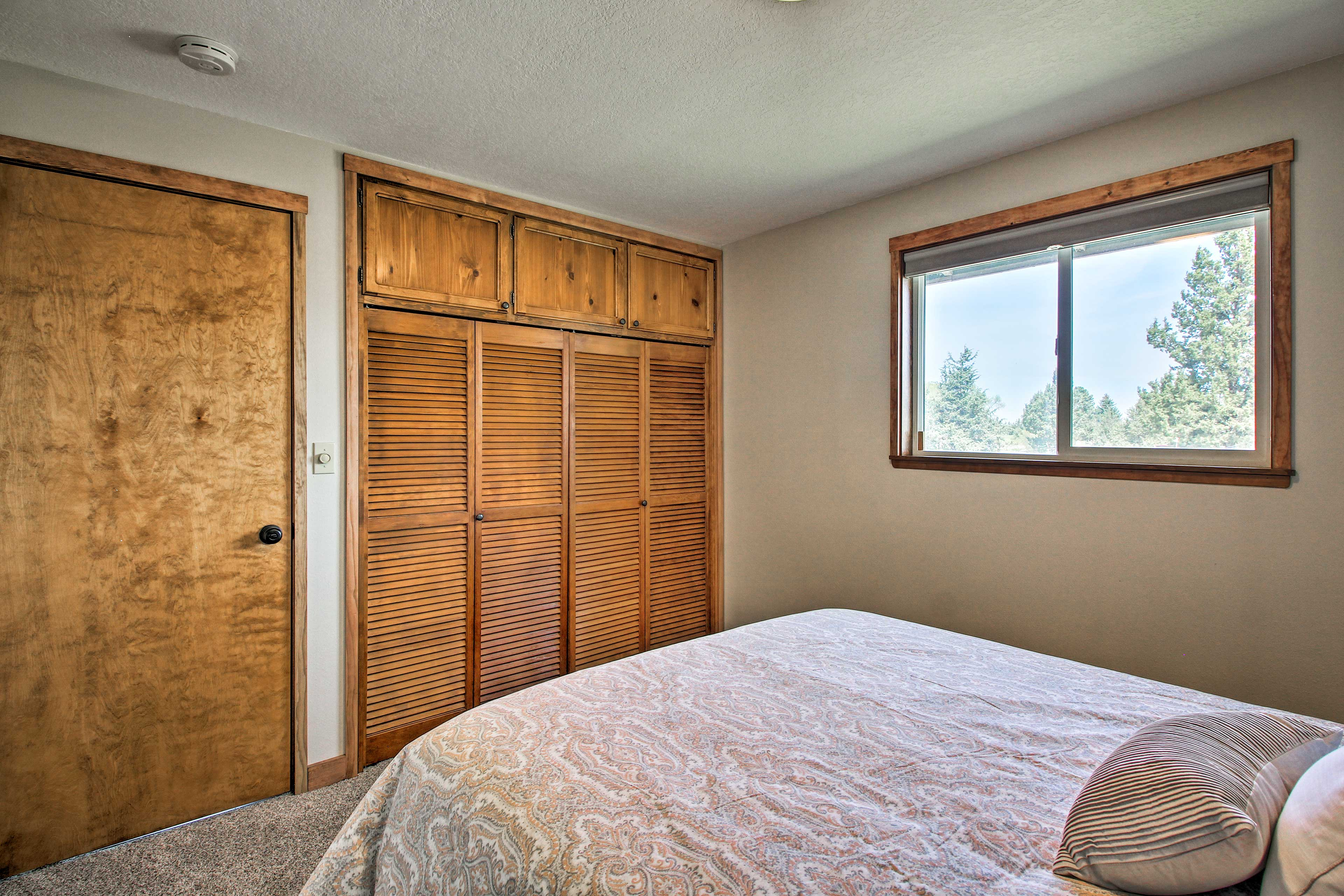 Rise and shine to natural sunlight entering the bedroom.